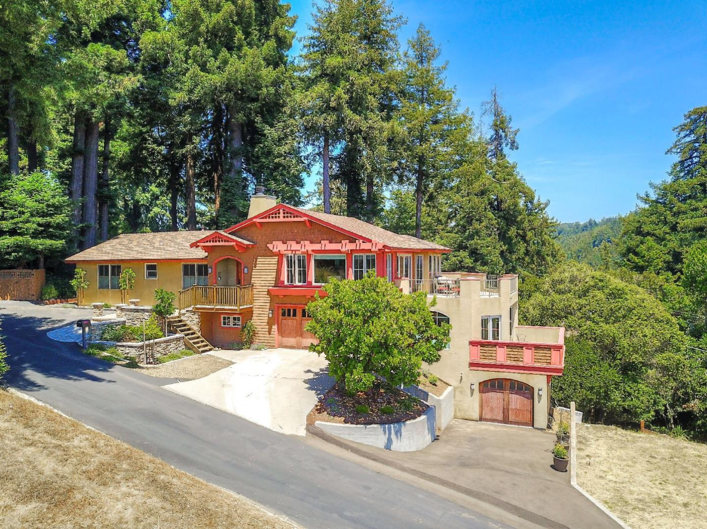 """Fabulous remodeled ocean-view home just 5 minutes to Soquel Village! This 2900+ square foot home is on nearly an acre with views of the bay and surrounding hills. Located on a private road, the 4-bedroom, 3.5 bath home boasts a Great Room with maple flooring, a wrap-around deck to enjoy the views and a wood-burning fireplace to cozy up to. There's custom cabinetry in the kitchen and entertainment area, plus Granite counters, a dual-fuel 36"""" Wolf range, a GE Monogram Refrigerator and Roy Johnson Lighting. Three bedrooms and two baths round out the main floor, plus a walk-in pantry. On the next level down, the ocean-view master retreat is a getaway in itself with a sitting area, its own deck, a walk-in closet and a gas fireplace. There is also a study/den area outside the master. Along with a half bath, the bonus area on the 3rd level is perfect for hobbies, yoga and other workouts or make it your own preferred space. Photos coming!"""