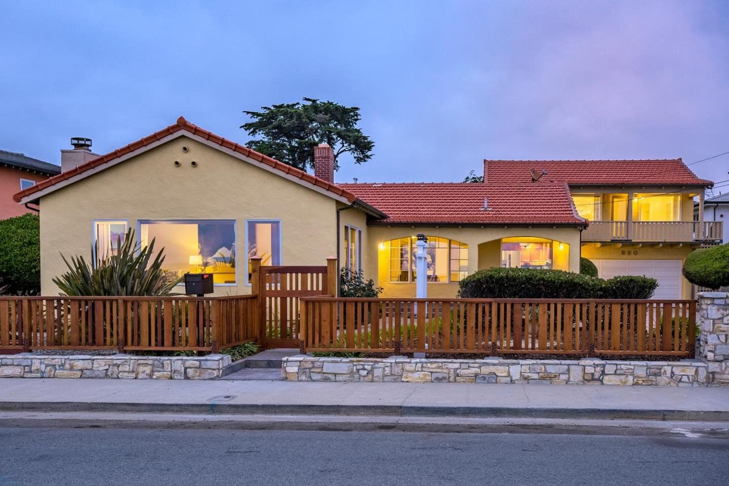 With Views from Mitchell's Cove to Monterey, here is a once in a lifetime opportunity to live on the premiere ocean front drive in Santa Cruz!  This remodeled 2800 sf home has 3 bedrooms and 3 1/2 half baths and is located on a double rarely available 13,000 sf lot.  Currently the utility poles are being put underground for unobstructed views!!!  Custom built with flexible floor plan that includes a guest suite with separate entrance & balcony. The remodeled kitchen has granite counters, stainless steel appliances and breakfast nook; perfect for morning coffee while watching the dolphins & whales. There are formal dining and living rooms with refinished hardwood floors & gas starter fireplaces overlooking the Pacific Ocean. The professionally landscaped lot has space to expand or for a cottage (buyer to verify) or pool.  With an over-sized 2 car garage & 300 sq ft. finished basement you will have room for all your bikes, boards & beach toys; the epitome of California Coastal Living!