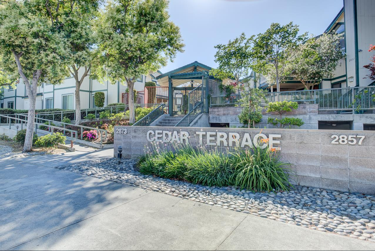 Elegant condo in Cedar Terrace community. This stylish 2 bedroom, 2 bath condo has been modestly updated with woodesque laminate flooring throughout, beautiful cool grey interior paint, updated bathrooms with contemporary cabinetry and granite counters. All electric kitchen with stainless steel appliances, shaker-style modern cabinets and granite countertop.  Separate eating nook overlooking private patio, and large living area with wood burning fireplace and breakfast bar.  Nearby amenities include grocery, Pruneyard shopping center and theatres, Los Gatos Creek biking/walking trail, downtown Campbell and easy access to interstates and expressways.