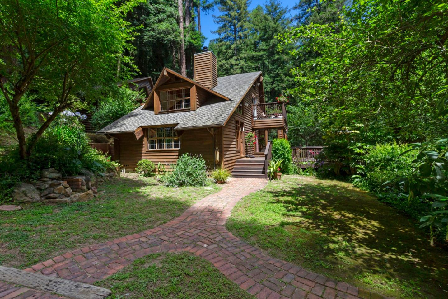 Private Wonderland Home on over 14 acres of pristine property. 3 BR/ 2 BA, 2,007 SqFt charming multi-level interior where natural light glistens in every room with over sized windows. Dramatic vaulted ceilings with living edge redwood beams. Living room has a stone fireplace with a woodstove insert. Large kitchen with breakfast bar and dining area opens to a sunroom. Master suite bedroom with an ensuite bathroom. 2 bedrooms have loft areas that provide additional space and room arrangement options. Fresh paint and carpet, and newer hot water heater. Exterior siding is built with heart redwood milled on the property! There are several decks to enjoy the peaceful nature surrounding the home. Well water and 5,000 gal water tank. Beautiful Corralitos location just walking distance to Windy Oaks Winery and a quick drive to popular Corralitos Market and Sausage Company and Corralitos Brewery! Enjoy a walk up to the top of property, have a glass of wine and take in the beautiful views!