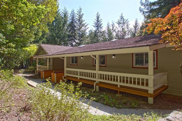Tucked away at the end of a private driveway, you'll find this spacious 3000 SF, single-level, updated home on over an acre!   Large and open family room with vaulted ceilings and loads of windows. Cheerful and bright with a stacked stone wood-burning/gas starting fireplace and rich wood floors.   Huge cooks kitchen with quartz counter tops, subway tile backsplash, stainless-steel appliances and an island with a prep sink! Spacious Master Suite with a room-sized walk-in closet w/ organizers and deck access. The  dining room can be used as an office or a 4th bedroom!  Sitting room across from the large entry, large wrap-around decks, and the large open flowing floorplan make this property ideal for entertaining!  Unusual 4-car garage and an even more unusual ~3000 SF basement  Wow!! Great opportunity for a home-based business, wine cellar, fabricator, you name it!  Less than 10 Minutes to Highway 1 beaches , 20 minutes to Santa Cruz, and less than 1 mile to Bonny Doon Elementary School.