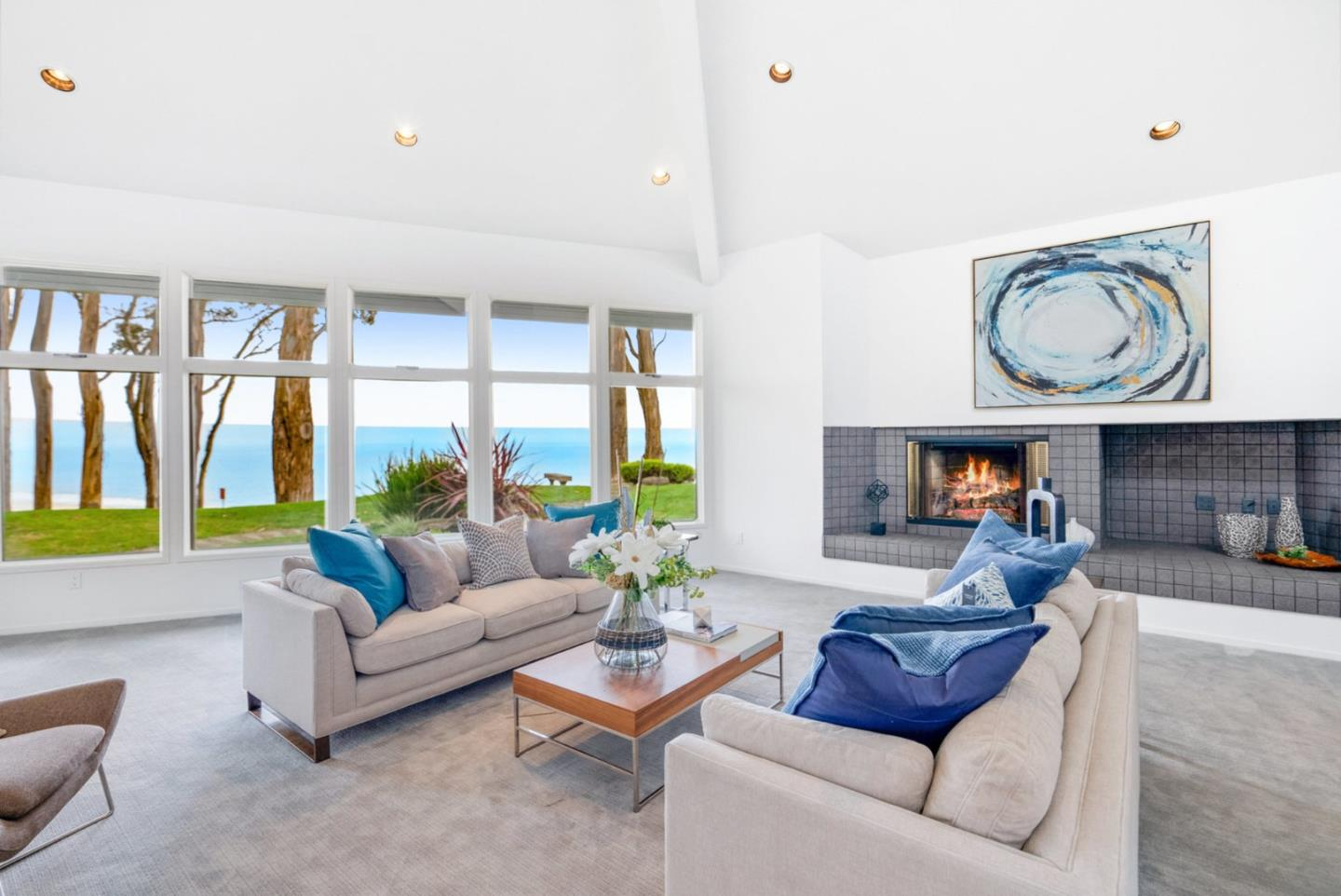 AMAZING Ocean Views. This timeless contemporary home was designed by George Foy & Associates to complement the surrounding environment.  Extensive use of windows and high ceilings provide sweeping Monterey Bay Coastline Views of ocean and sand. This home was built on one of Seascape's prime lots on a prominent point allowing unobstructed views. The 1st floor has Lrg dramatic LR w/fireplace & a wall of windows overlooking the Bay, dining room, kitchen with large walk-in pantry, family room, and 2 en suite guest rooms.  All rooms have spectacular Ocean views. The office/fourth bedroom has a small blue water view.  The first floor also includes a laundry room and attached three car garage.The entire  second floor encompasses the Master Suite with gas fireplace, steam shower, tub, his and hers walk-in closets, dressing room and a separate sitting room, with ocean/beach views from every room in Master. www.1114viamalibuaptos.com