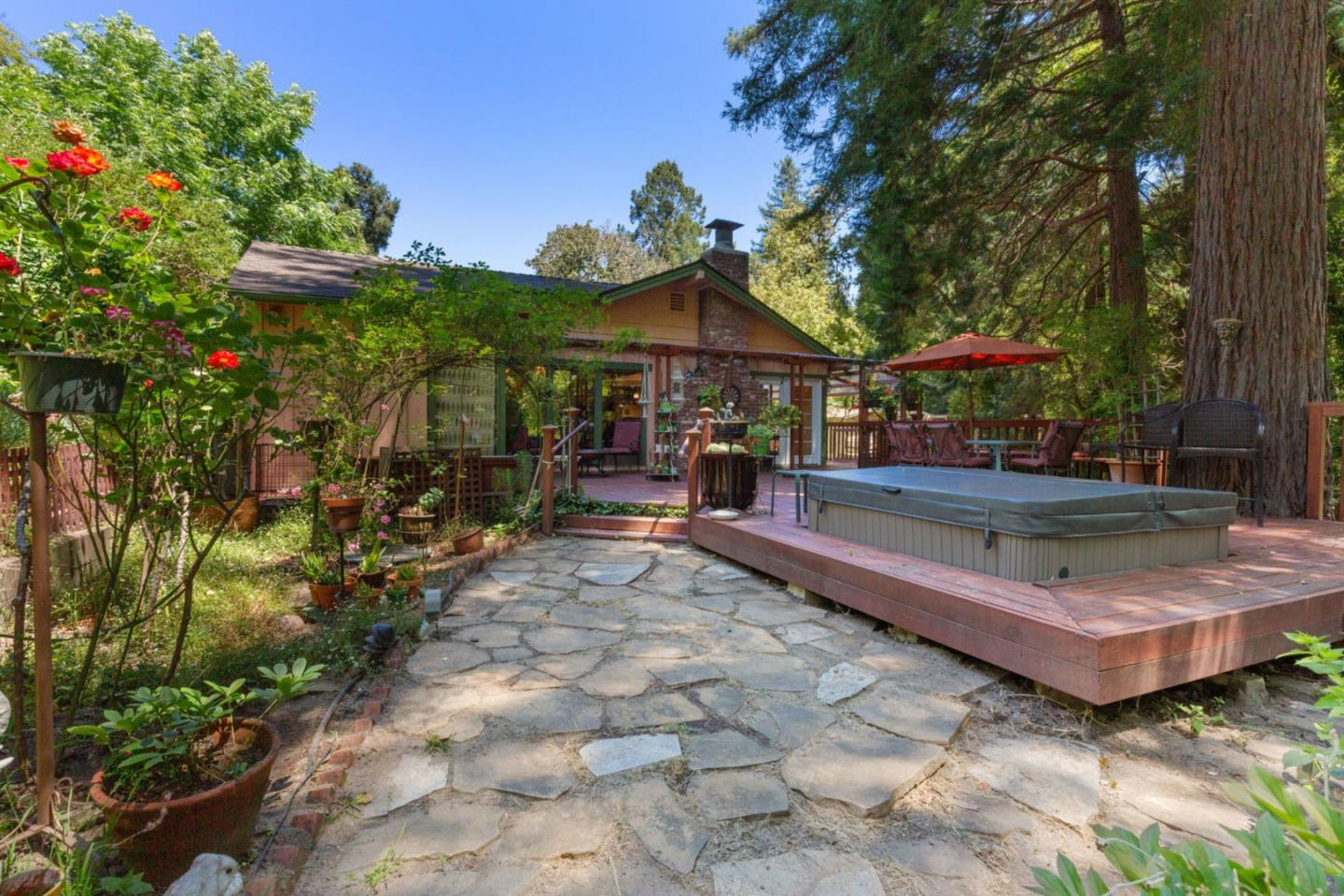 This 3 BR/2.5 BA on 0.9 acre creekside property has everything you need for everyday bliss! This home has a large great room with bamboo flooring, updated kitchen and dining areas, and a beautiful fireplace that acts as a focal-point. Downstairs bathroom has been recently remodeled with a jetted tub and a glass sink vanity. Master suite in upper level has vaulted ceilings and an ensuite bathroom. Guest bedroom has a built-in murphy bed! Roof and exterior paint from 2016 and 2018. The property located in a sunny, sought-after neighborhood is a true paradise with creek views, fragrant plants and roses, fresh mountain air, local wildlife, and large rear-deck featuring a hot tub and space for entertaining. For additional natural splendor Quail Hollow Ranch County Park with nature trails is only 1 mile away. 5 min from downtown Felton with Cremer House restaurant and White Raven cafe. The 30x30 garage has been converted into a music studio for, but can be used for many uses.