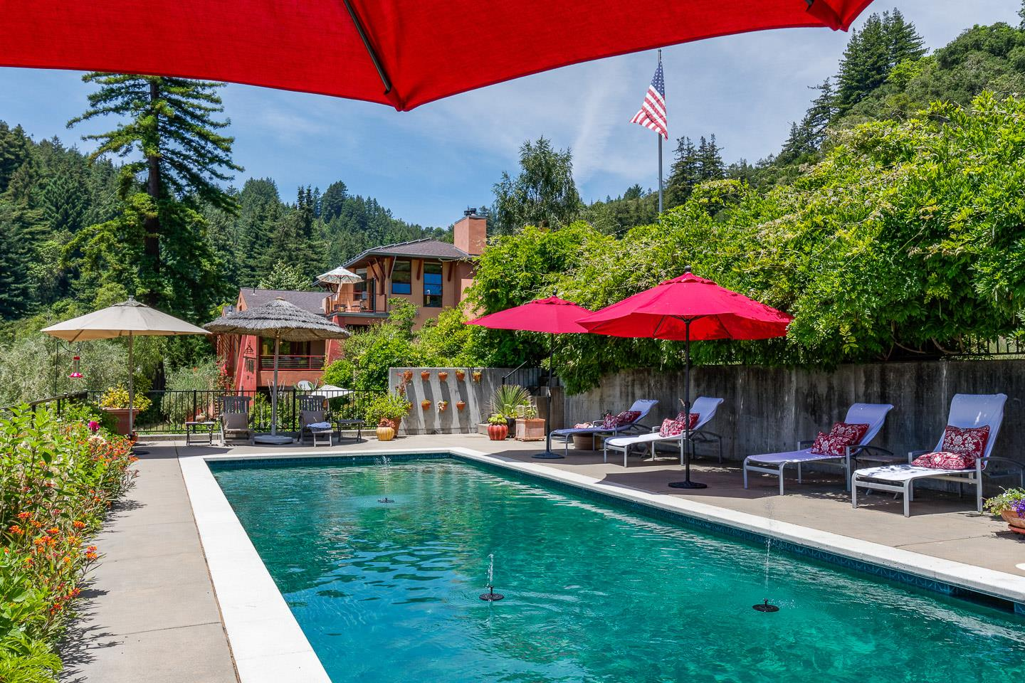 Stunning Tuscan-flavored California modern home/estate in Santa Cruz wine country just minutes from the beach & an easy distance from Silicon Valley. A dramatic entry reveals an open floor plan with expanses of windows that emphasize relaxed indoor/outdoor living. Featuring a 13 x 40 salt water pool, Mugnaini wood fired pizza oven, extensive plantings & fruit trees, plus a 150 tree olive orchard producing commercial quantities of organic, extra-virgin olive oil. Architecturally significant banana-belt home surrounded by redwoods and native oaks, overlooking vineyards, with views to the Santa Lucia Mountains and Ventana Wilderness in the distance. High ceilings, Brazilian cherry, maple, and polished concrete floors, and finest quality fittings & finishes throughout. Airy gourmet kitchen featuring Wolf, Miele, SubZero & Thermador appliances and expansive granite counters. Privacy off a gated, private road, yet close to amenities,things that make Santa Cruz special. APN107-531-10 included