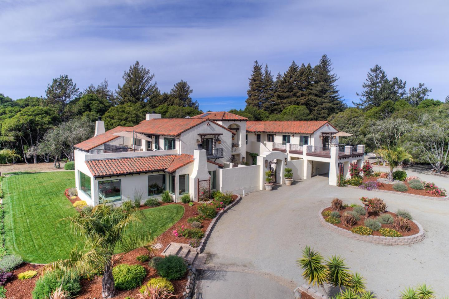 Panoramic views of Monterey Bay, quality craftsmanship and luxury embody this unique estate, with a balance of privacy and tranquility in a coastal location perfect for a commute to Silicon Valley. Extensively remodeled/expanded in 2009 and upgraded by the current owner, this masterpiece boasts incredible indoor/outdoor venues, four full en suite bedrooms including a first floor lavish Master retreat, and great room with sleek gourmet kitchen, bar, lounge and huge picture window views. A fusion of modern amenities  including an elevator and design finishes amplifies surrounding natural beauty, including a calming blue-gray paint palette, stunning limestone floors, granite and sea-glass colored accents, custom crafted lighting and warm wood tones. The elegant exterior features a secluded courtyard, loggia and decks with spectacular views. Tucked away on a small gated country lane, the expansive grounds feature lawns, colorful gardens and ample space for a pool, sports court or hobbies!