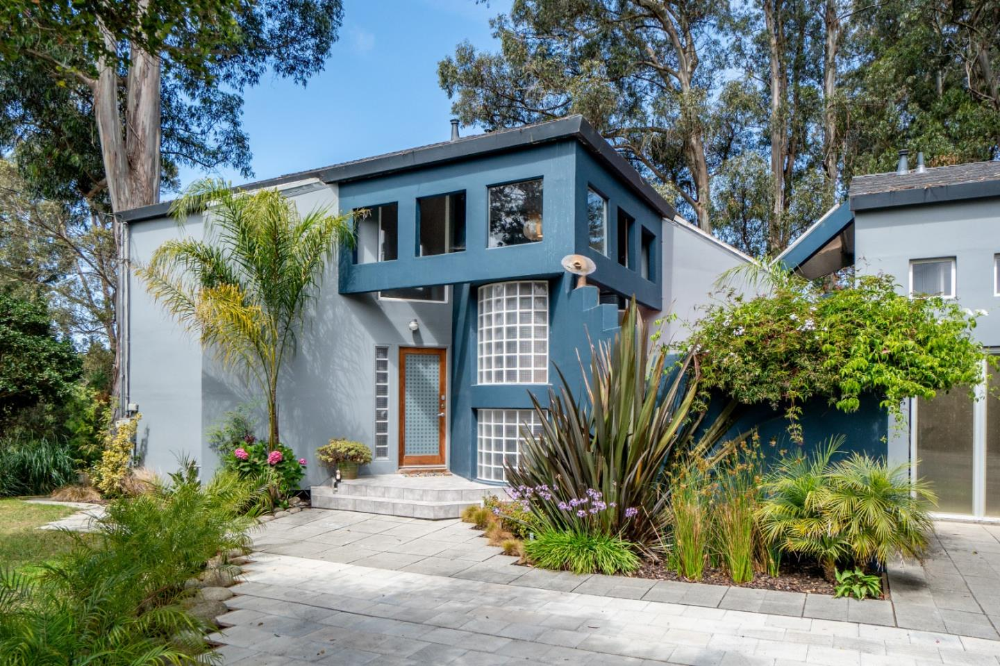This unique La Selva Beach property makes available over 4000 sf of living and multi-use space through creative interior alterations by the owner/architect. This 9 year old custom built home lives as a 5 bedroom, 5.5 bath. Located less than .5 mile to the private La Selva Beach, Manresa State Beach, or the Village Center. This multi-level home is situated on a double lot with upper and lower driveway access from 2 different streets, allowing for ample off-street parking. Multiple entertaining spaces include decks on all 3 levels, private courtyard and sheltered lawn area bordered by lush landscaping. The living room features 12-ft ceilings, gas fireplace, large custom skylights and direct access to outdoor spaces. The entire upper floor is a fabulous master suite with a foyer opening to a large private deck with beautiful panoramic views, dressing room with ample closet space, separate his/hers vanities and freestanding tub with wine refrigerator for a private retreat in your own home.