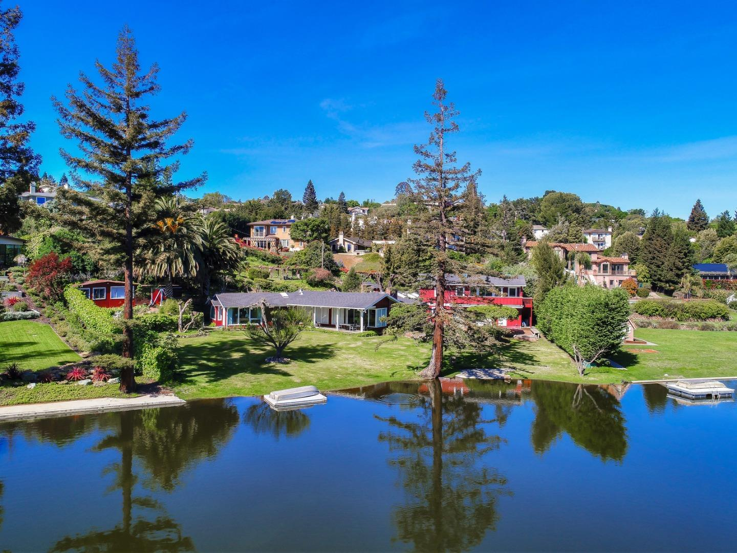 This property is a rare opportunity in the Bay Area.  This single level Lake front home on the privately owned Lynda Lake is truly special.  The location provides one of the most tranquil settings to live in the bay area.  Sitting on a 41,921 square foot lot this property is one of the most desirable lots of the 11 original homes that rim the lake.  These homes of distinction on the Lake have been historically sought after.  With all the privacy and peacefulness of a home in the county you are only minutes from highway 280, shopping and schools. This special property is one you must see.  You won't find this type of property anywhere on the Peninsula! It is more than just a  home!