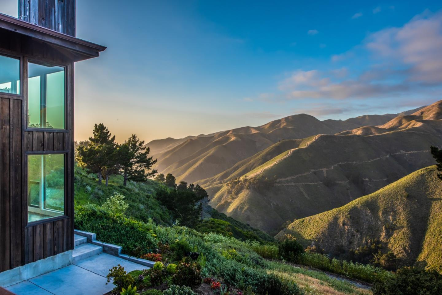 Designed by renowned Big Sur architect Mickey Muennig, who is known for his work at the luxury eco hotel Post Ranch Inn, this magical home comprised of walls of windows soaks in the environment day and night. The main house has four bedrooms all with incomparable views plus an additional one room guest cottage.  In an exclusive area above Garrapata State Beach, this 10-acre property is a masterpiece that magnificently blends the Pacific's grand horizon and the rolling landscapes of the Santa Lucia mountains into luxury.  The finest craftsmanship and materials meld with the environment harmoniously to create a sophisticated and relaxed-vibe escape that is only fifteen minutes from the town of Carmel.