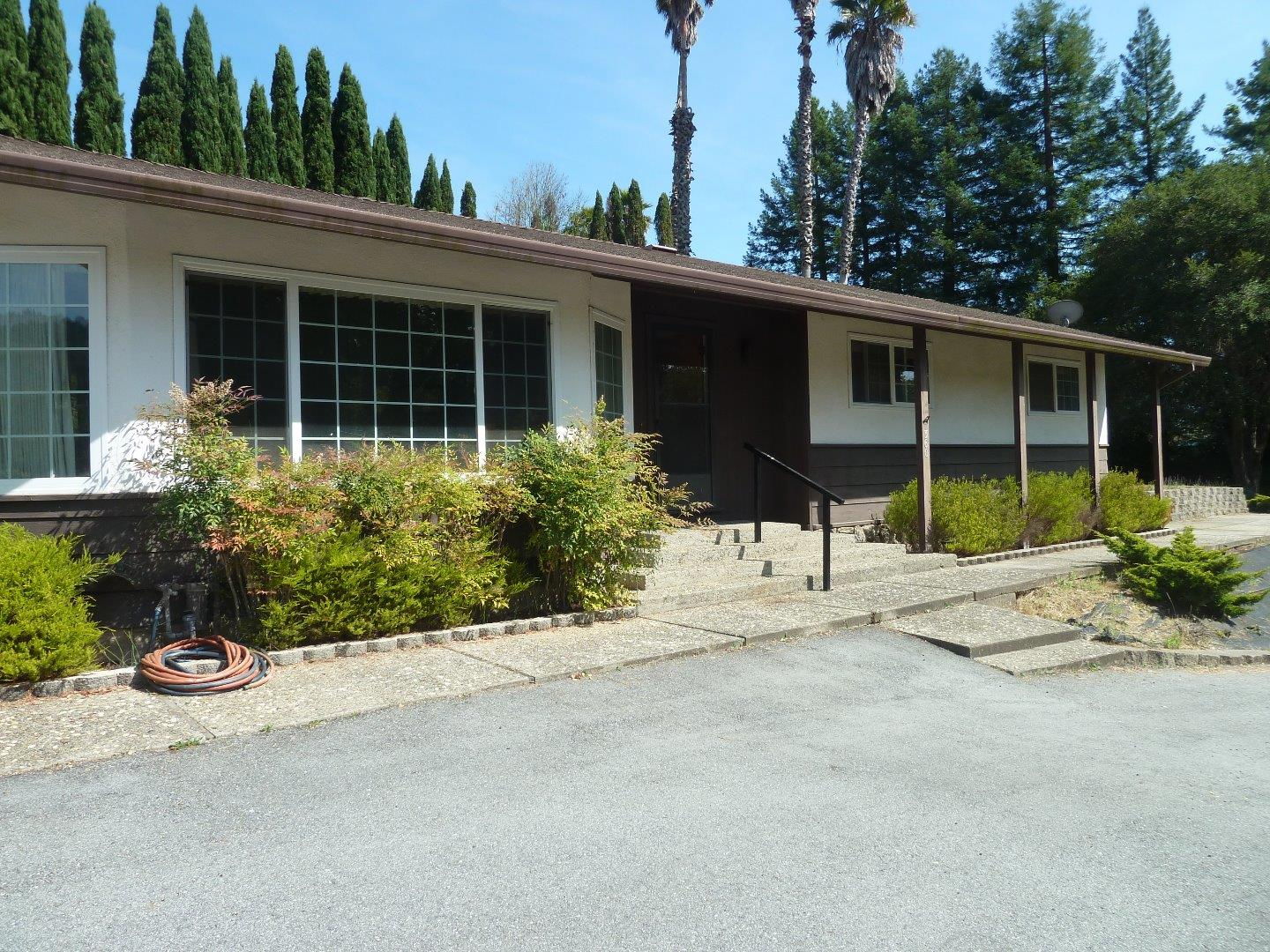 Out of the fog in glorious sunny Corralitos this 3 bedroom 2 bath home has plenty of room for family, hobbies and entertaining. Sunken living room with gas fireplace opens to a separate formal dining room. Kitchen with built in oven and cooktop and breakfast bar adjoins a sitting area with sliding door to covered patio. Hot tub access from patio or directly from master bedroom.  RV parking with clean out into public sewer.  Huge attached garage with attached large workshop is ideal for big projects. Public utilities including sewer.  Minutes from Corralitos Market  - it is the perfect location.