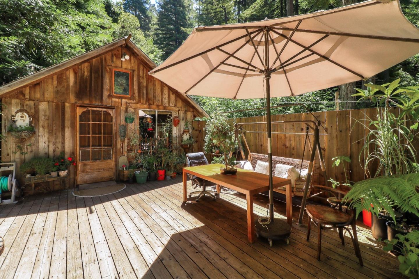 A private and peaceful sanctuary with lots of sunshine and ample gardening space nestled amongst the redwoods. The property was just appraised in August of 2019 for $397,000. Enjoy the perfect blend of an indoor and outdoor lifestyle - the main living space flows right out to the massive deck with views of the pristine babbling creek and forest down below. Connect with nature by watching and listening to the sounds of the year-round flowing creek, multiple species of birds, dragonflies, butterflies, and ladybugs. End your day by climbing into the hot tub and watch the moon traverse the sky between the trees. In addition to the house, there is a workshop space with running water and electricity. High-speed internet is available at the property. This home is located approximately 8 minutes up the road from the famous Corralitos market.
