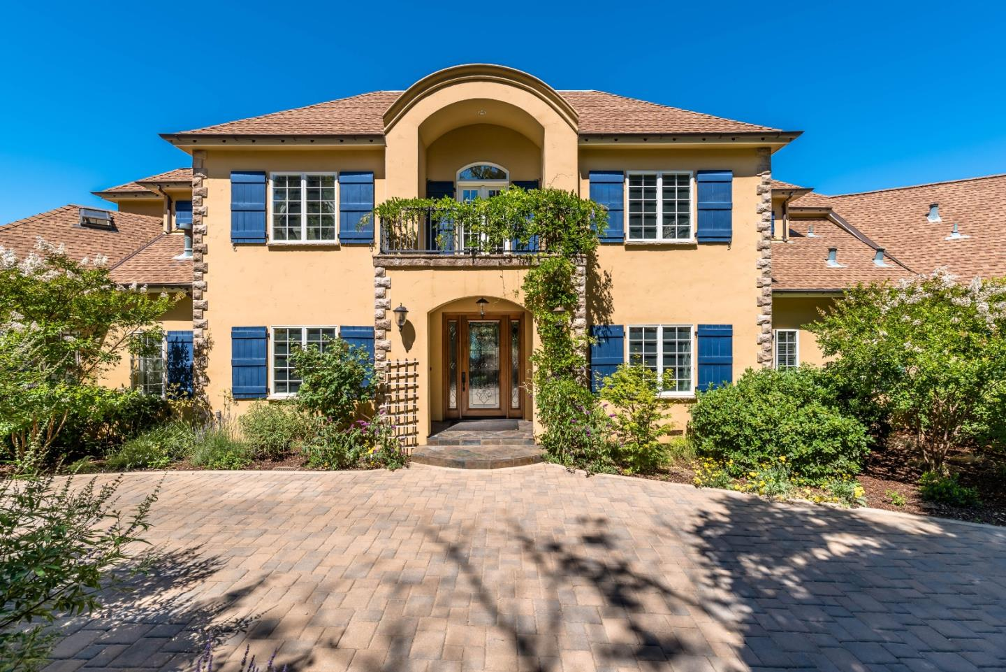 This Formal French Country Estate with the Finest European and Contemporary Finishes blended with Modern Home Technology is the definition of Sophistication and Elegance offering a Warm and Inviting Opportunity for Peaceful Outdoor Living among Nature. Enjoy this stunning 5 bed/ 6 bath ~5,600sqft Home and Grounds,~1,317sqft 1 bed /2 bath Guest House and ~9,000sqft Barn w/ workout room, sport court, stalls, and unlimited storage. Explore nature among the gorgeous ~21 acre parcel. Entertaining is a dream come true w/ Abundant Professional Grade Amenities Designed for the most Discerning Epicurean Convenience in the Indoor and Outdoor Kitchens and Dining as well as the Bar/Billiards/HomeTheater areas.  Colorful California Sunsets illuminating over multi ridge vistas of the majestic Mountains w/ peeks of the Monterey Bay from nearly every room and gorgeous outdoor living/entertaining spaces; patios, terraces + jaw dropping veranda, dual waterfall pool, hot tub, outdoor kitchen, and dining.