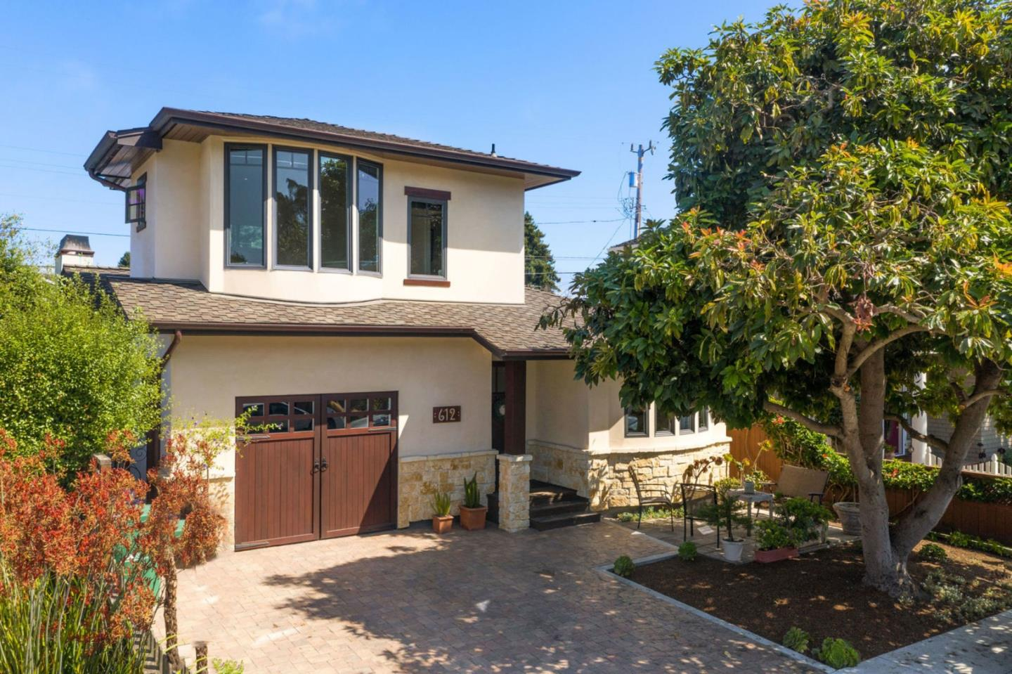 One of a kind home in the highly sought after Riverview Terrace Neighborhood. This fantastic location is a short walk to the beach, Capitola Village, Nob Hill, and Gayles Bakery. Home was rebuilt in 2013 with quality finishes such as copper metal on exterior, Nana Wall folding patio door to back yard, Viking/Thermador appliances, Du Chateau wide plank flooring, Double sinks in master and double heads in shower with Steam Shower, Grohe fixtures, custom cabinetry, and Solar Panels. Mostly single level living with master bedroom, guest bedroom/bath, kitchen, living, dining, and laundry all on main level. Upstairs features large bedroom and half bath. A rare find for Riverview Terrace!
