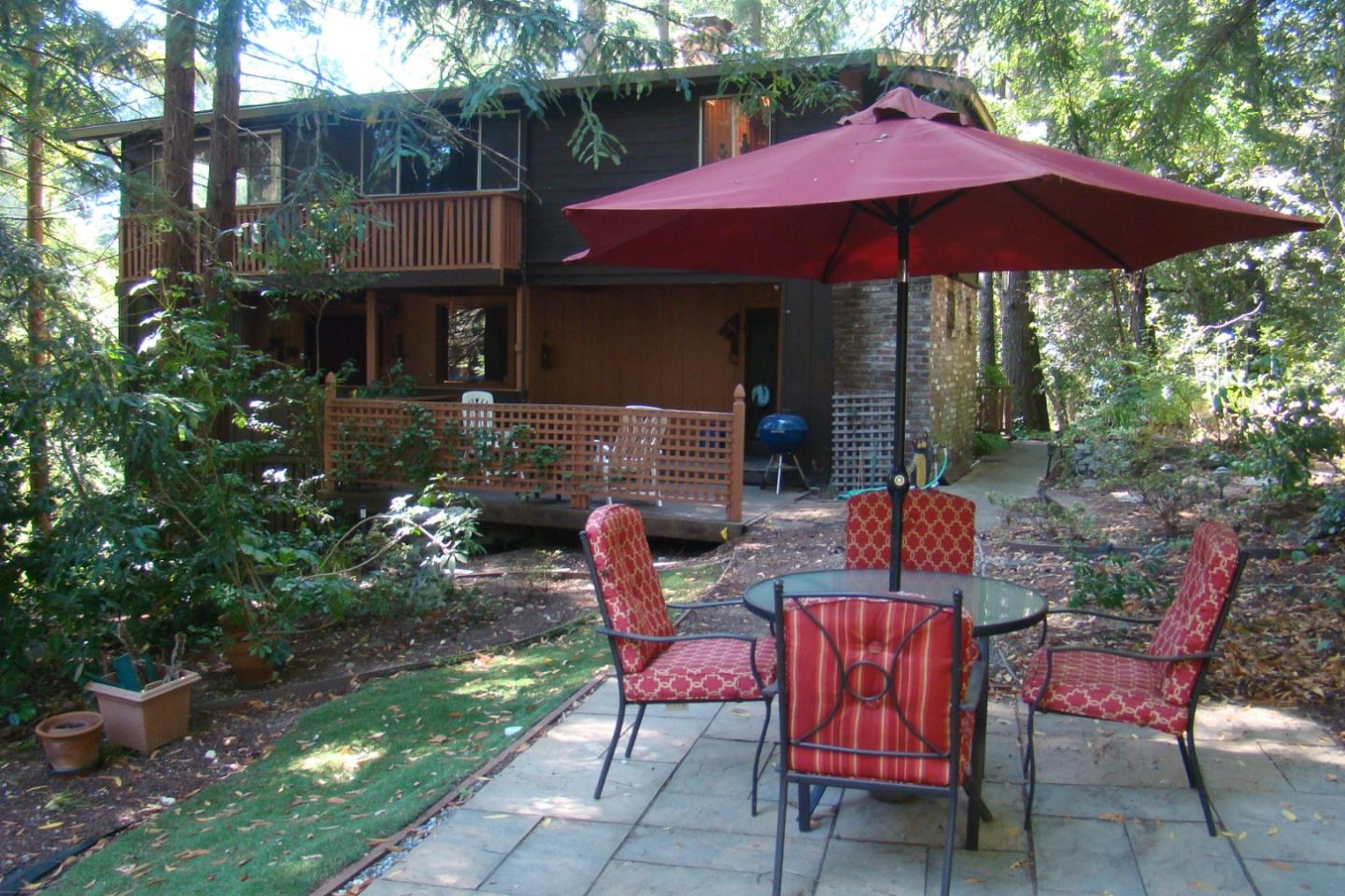 """Great opportunity with many possibilities.  Beautiful, gentle slope, 1/2+ Acre parcel with a 5 Bedroom/2 Bath 2271 Sq. Ft. home in Beautiful Mount Hermon Park. Originally built about 1911, this home has the feeling of a  """"lodge"""" with unique character.  Features include a  large living area with fireplace,  kitchen and separate dining area, upstairs library room with a pot-belly wood stove and  5 bedrooms (including one of the bedrooms as a """"secret room""""), and an adequate  basement area for a workshop and/or storage.  The use of beautiful original growth redwood throughout the home takes you back to the early 1900's """"in the woods"""" living experience. The home and recently replaced septic system are positioned on the parcel allowing a very large unused usable area.....perhaps for a """"granny unit"""" or ADU?  Regardless, use your imagination!  Mount Hermon Association is not an HOA, but there are optional amenities and a $440 annual Roads-Trails-and Bridges Assessment. Great commute location."""