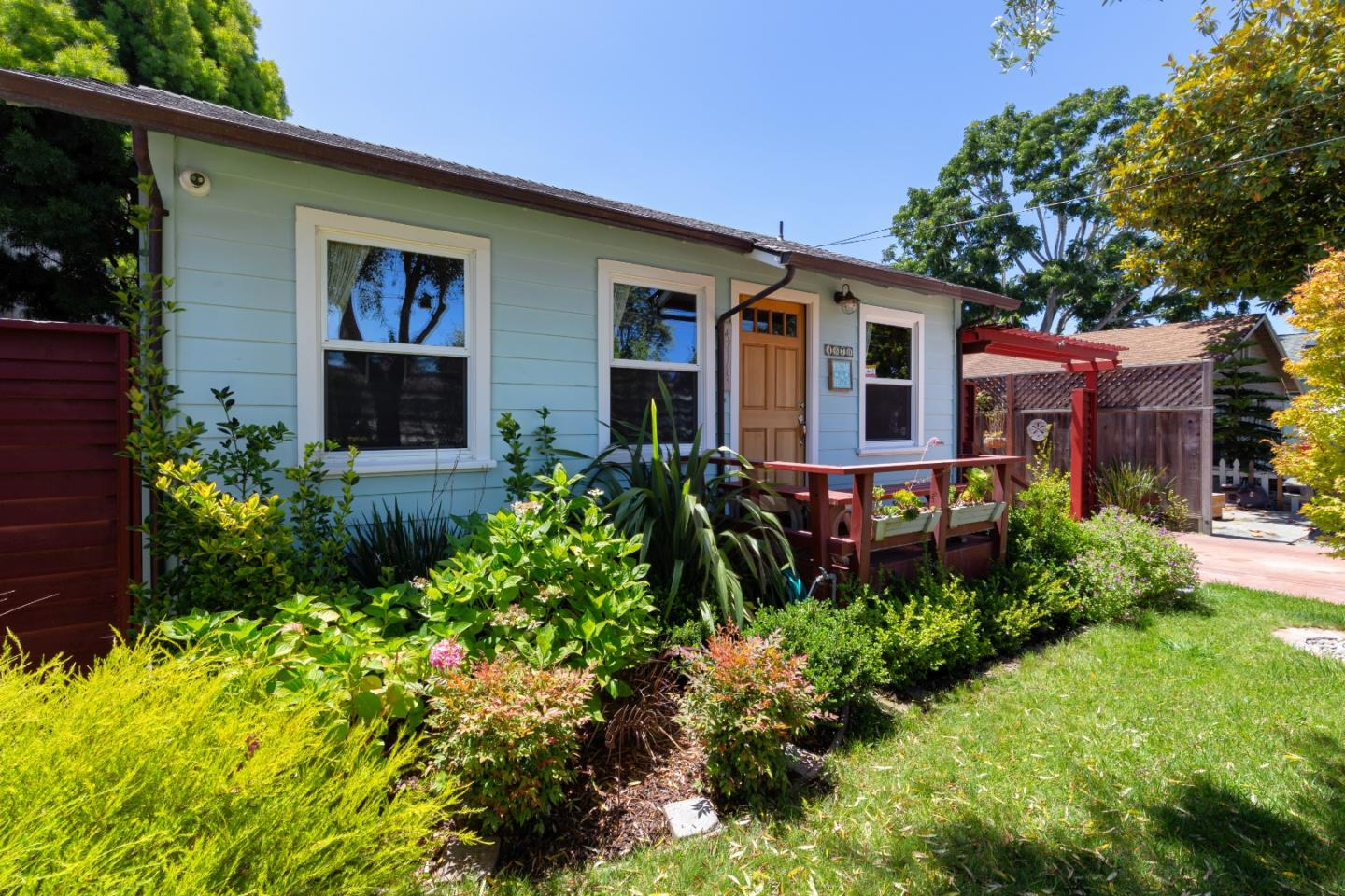 Location, location, location! Don't miss this charming, single level french garden cottage in the popular Capitola Jewel Box area.  Within walking distance to Capitola Village, the Wharf, the beach, Shadowbrook Restaurant, shopping and so much more. Bright and light home has been lovingly updated with bamboo floors, remodeled kitchen and master bath.  Garage has also been updated.  Call for list of all upgrades. Every room is wired for CAT 6 data and there's a high end LTS security system - both accessible from your phone.  Private backyard retreat with southern exposure - perfect for sipping your morning coffee or having a fun party.  Lush front yard is low maintenance with it's underground sprinkler and drip water system.