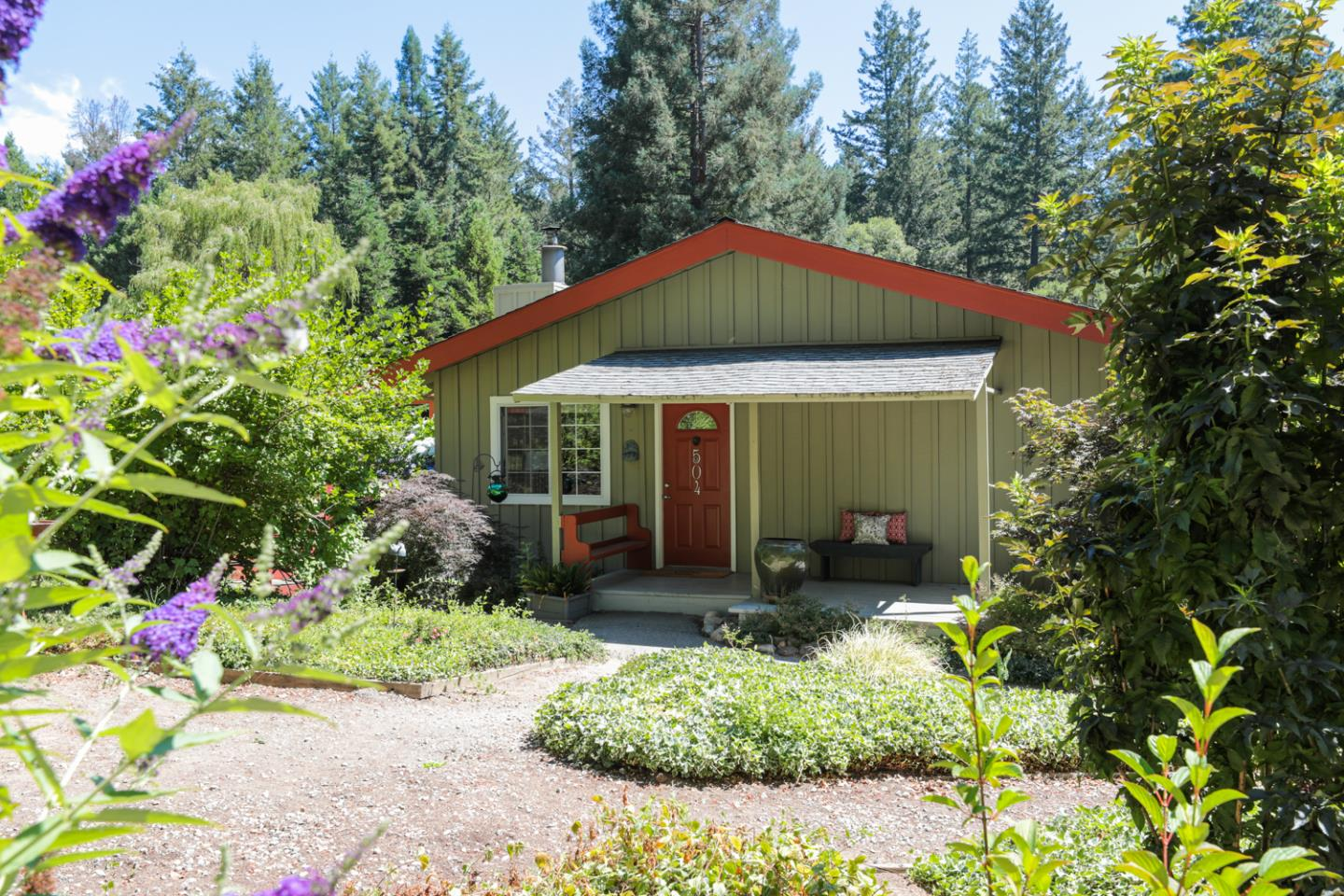 This home offers privacy & tranquility on 1.35 sun drenched acres in Bonny Doon. This treasure is more than a home, it is a lifestyle. The darling 2-bed/1-bath single level home sits proudly among a plethora of lovingly tended fruit trees, vines, flowers & vegetable gardens. This 1,084 sq ft, open ceiling home has been tastefully updated. The gourmet kitchen features blue tile floor which complements the earth toned granite slab countertops & natural wood stained cabinets. Its equipped with a Wolf stainless-steel gas range & electric oven. Several skylights allow natural light to enter the home & the white-washed walls & ceilings has a fresh & welcoming feeling. The outdoor deck has lots of area to play and explore for children & adults. The large wooden deck & pergola is perfect for relaxing & barbecues  in the late afternoon sun. Playhouse with swings & a slide, a horseshoe pit is just the beginning of things to do! Bonny Doon school is just down the street. Minutes to the coast.