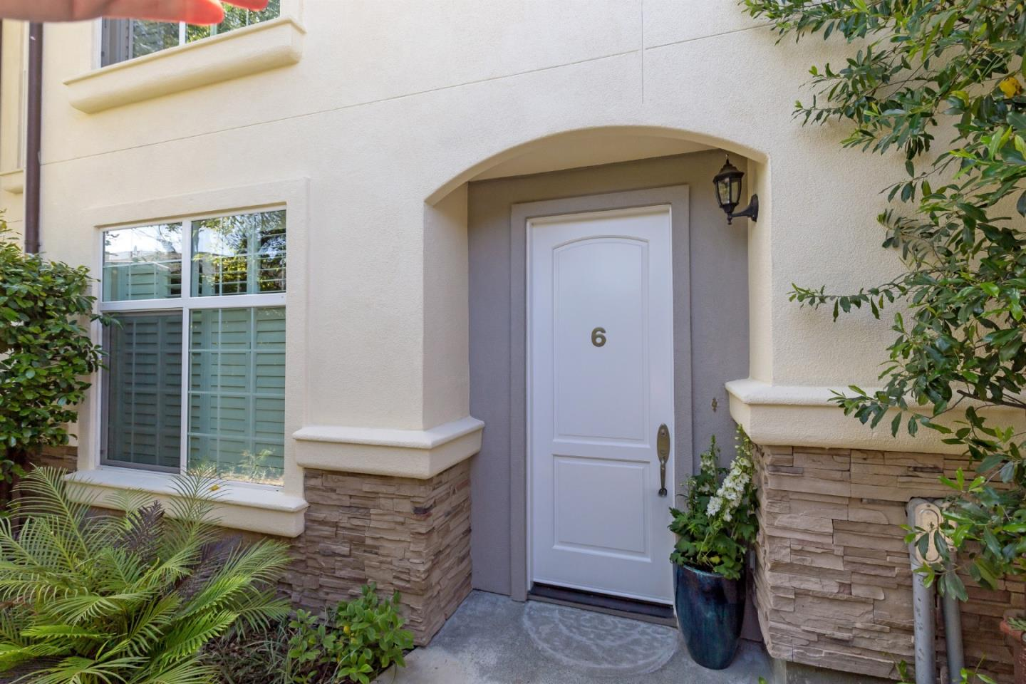 Stylish downtown living awaits at this desirable corner-unit townhome just blocks from the Village. Towering ceilings, oversized crown moldings, and plantation shutters create a luxurious ambiance in this two-story home. The living areas are on the upper level benefitting from the tall ceilings and abundant natural light from clerestory windows and French doors to a private balcony for fresh-air living. The chefs kitchen is impressively appointed, a fireplace enhances the setting, and two bedrooms, each with en suite bath are privately located on each level. An attached 1-car garage with laundry adds to the appeal. With shops and restaurants just blocks away, access to excellent Los Altos schools, and Highway 280 close by, this is an excellent option for Silicon Valley living!