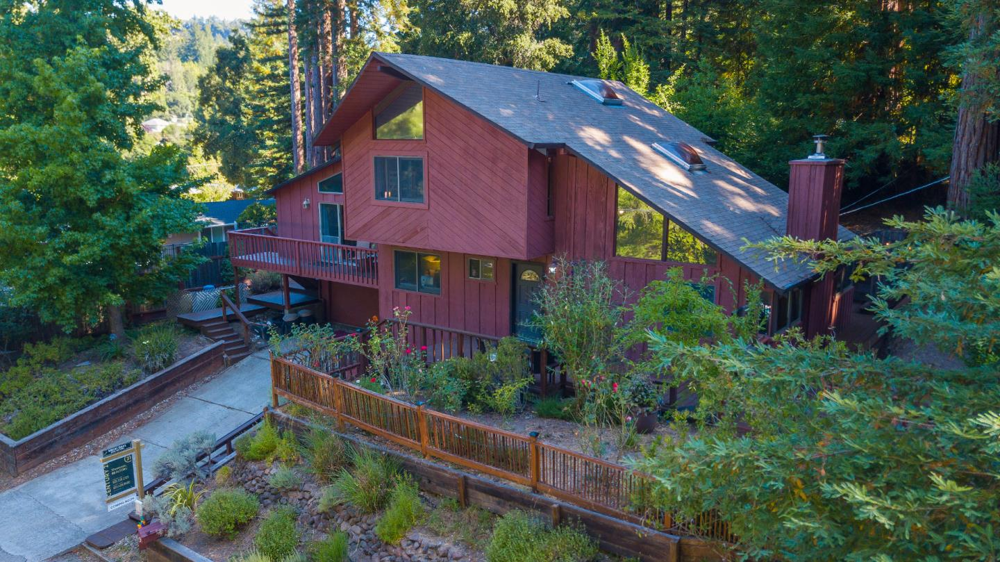 Lovely 4bed/3bath home in sought after Bear Creek Estates. Thoughtful, well designed floor plan could allow bedrm, bath and family room to be 2nd unit with addl exterior access. Architecture is Wittenberg. High beam ceilings and lots of natural light create a sense of spaciousness and comfort. Valuable pecky cedar paneling adds to the rustic and visually pleasing environment. Recent tasteful upgrades to master bath, kitchen, carpets and lighting. Only 2 blocks from the newly acquired Boulder Creek Rec & Parks swim and racquet club with year round activities available to the public. Great commute location, only 20 min. to Los Gatos. The quaint town of Boulder Creek with award winning schools is nestled on a scenic forested corridor, with nearby State and County parks, biking, hiking, equestrian trails and 18-hole golf course. No hustle and bustle here, just peaceful cohabitation with the best that Nature has to offer! On sewer, NO septic. Alterra evaluation says yes to solar if desired.