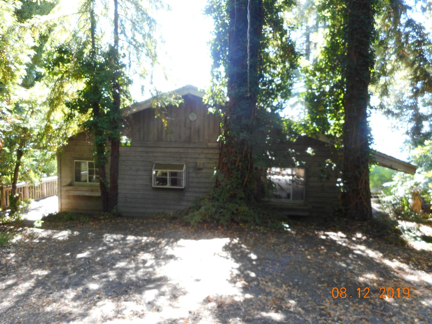 41 acres with a large house in pristine Santa Cruz mountain setting. Bank owned REO. Tons of potential. House is a fixer upper. The land has some gently sloped areas and some steeply sloped ones.  Driveway is NOT for cars with low clearance. 4 wheel drive would be best. Please do not go to house without consulting agent, there are hazards in and around the house. Buyer to investigate future use of land, seller and seller's agent make no predictions about future use. Gorgeous views all the way to coast in the distance. Forest setting. Once again - there are safety concerns. Please call L.A. prior to visiting. This property will NOT qualify for conventional financing. Cash or Hard Money loan only.
