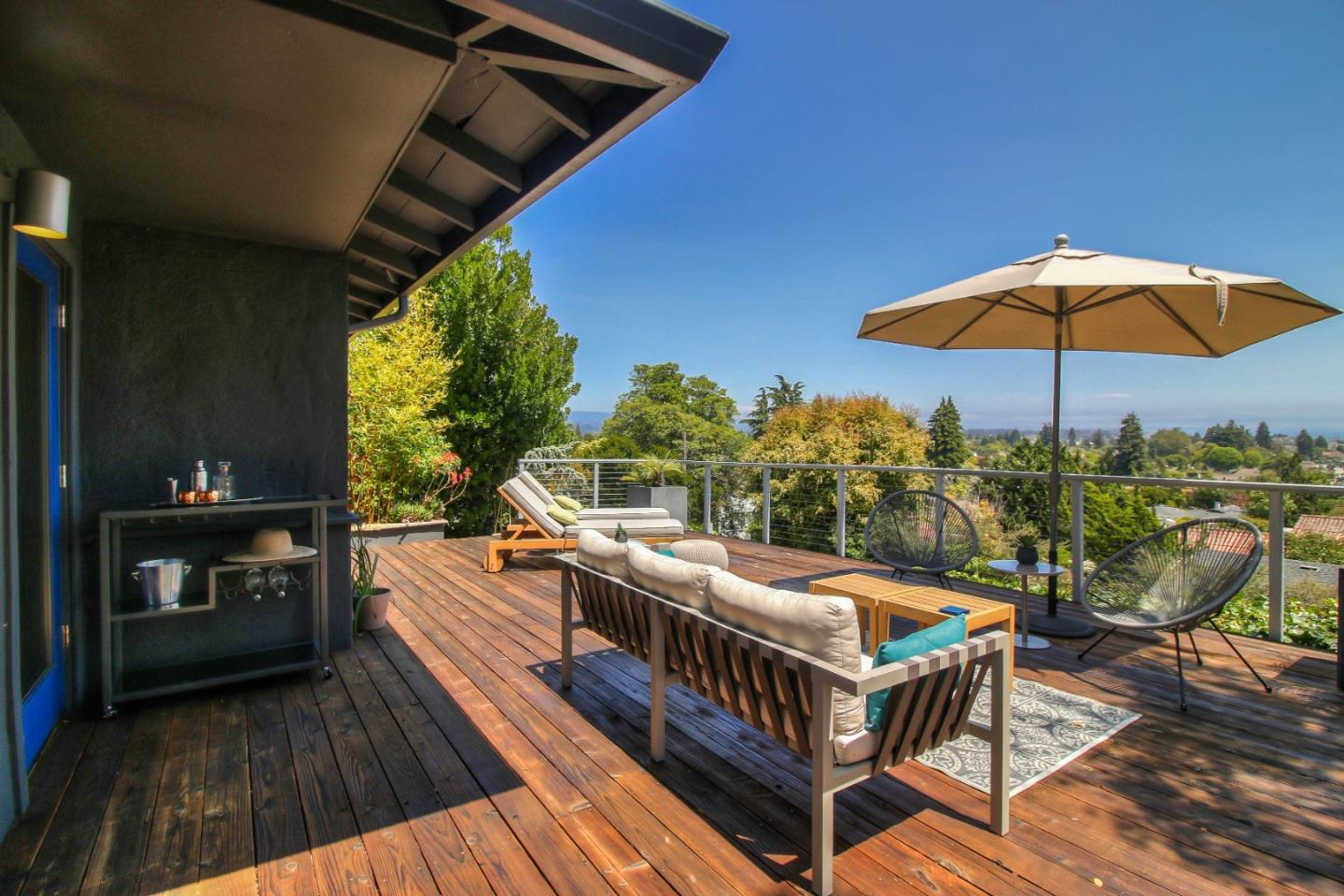 This prime property on the upper side of Escalona Drive has incredible views of the city and the bay. Architect-designed and managed remodel will knock your socks off (in case the view didn't already). The interior spaces are modern, comfortable, and happy. The views from the front deck and house are breathtaking. The backyard is inviting and soothing. The house is perfect for enjoying alone and with your family, or entertaining guests. The single-car garage has a motorized lift for a second car.