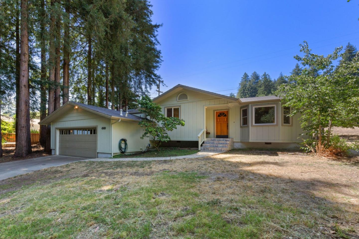 A little bit of country, but so CLOSE to town. This is the 3rd home back off La Madrona Drive, located on a private road, and only minutes to Highway 17 access. The living room has a big, bay window with seating bench. The kitchen has a breakfast bar, center island for prep, & an abundance of storage. A generous Master Suite features an updated bathroom and walk-in closet. A slider features views of the outdoor space where wild turkeys, rabbits, and the occasional fox make their appearance. The majestic Redwood Grove provides just enough shade to keep the house cool in the summer heat, while the rest of the third acre parcel has great sun exposure with plenty of gardening space and room for chickens. This location offers the best of country living while still being close to the comforts and convenience of town. Located nearby Henry Cowell hiking & biking trails, La Madrona Athletic Club, a short drive to Santa Cruz beaches, & within the highly desirable Scotts Valley School District.