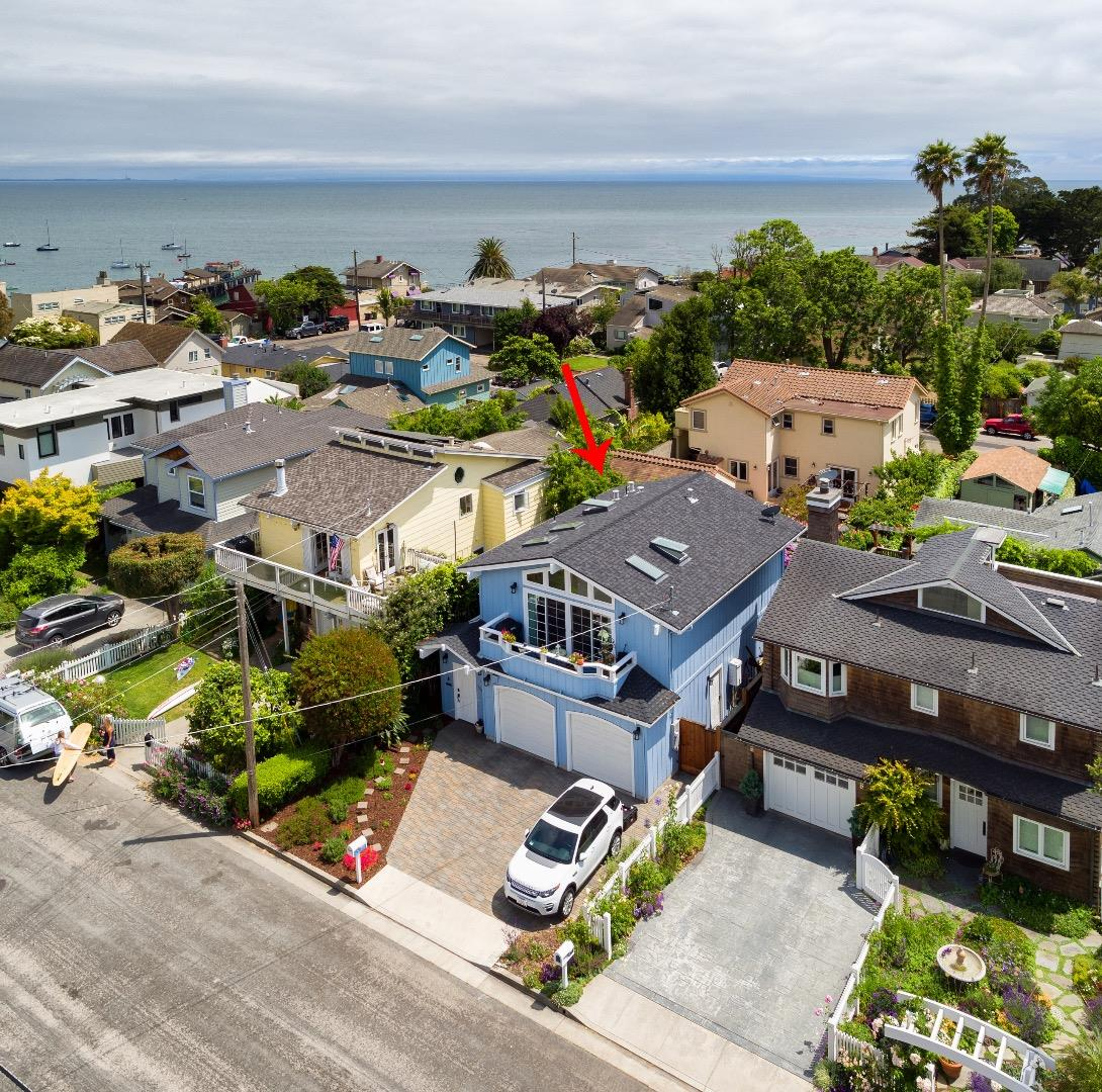 Dream location a short walk to the Beach, Wharf, Capitola Village and Whole Foods. Thoughtfully remodeled in 2015 as their forever home.The open concept reverse floor plan has 5 skylights in the vaulted ceiling to brighten each day. Rich walnut floors throughout upper level.  Heavenly, totally new kitchen with prize AGA Legacy stove (both gas & electric) custom cabinets, quartz counter tops, farm sink and much more.  Downstairs tiled hallway and  bathroom floors have radiant heat for those chilly mornings. Private, gated entryway leads to the front door and southern exposure back yard with privacy. The remodel is studs out with new plumbing, electrical and insulation. New heater and vents. Asbestos abatement and replace dry wall with bull-nose corners. New 40-year roof 11/18. Newer garage and garage doors. 3-220 volt car chargers. Ecobee thermostat. Surfer shower plumbing. On-demand water heater. Ring doorbell.  Newer double-pane windows and sliders. Everything done with permits.