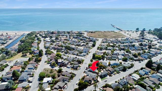 As you pull up to 207 El Camino Del Mar, you see the ocean just down the street, and you smell beach in the air.  From the curb, the modern lighting, fresh landscaping, single-level floorplan, two-car garage, and custom contemporary door scream coastal living.  It does not, however, stop at the curb, as you step through the front door there is modern new flooring, fresh paint, designer lighting, double panel windows, stainless appliances, and a gas burning fireplace insert.  The backyard has a luxurious hot tub, fruit trees, the yard is fenced for children or a dog to run, and the landscaping is low maintenance.  If you love to walk, beach access is easy, and the amenities are close by including coffee, Mexican, pizza, burgers, ice cream, and a corner store.  If you're a buyer looking for functionality, ease of maintenance, coastal living, and move-in ready...this might be your match!