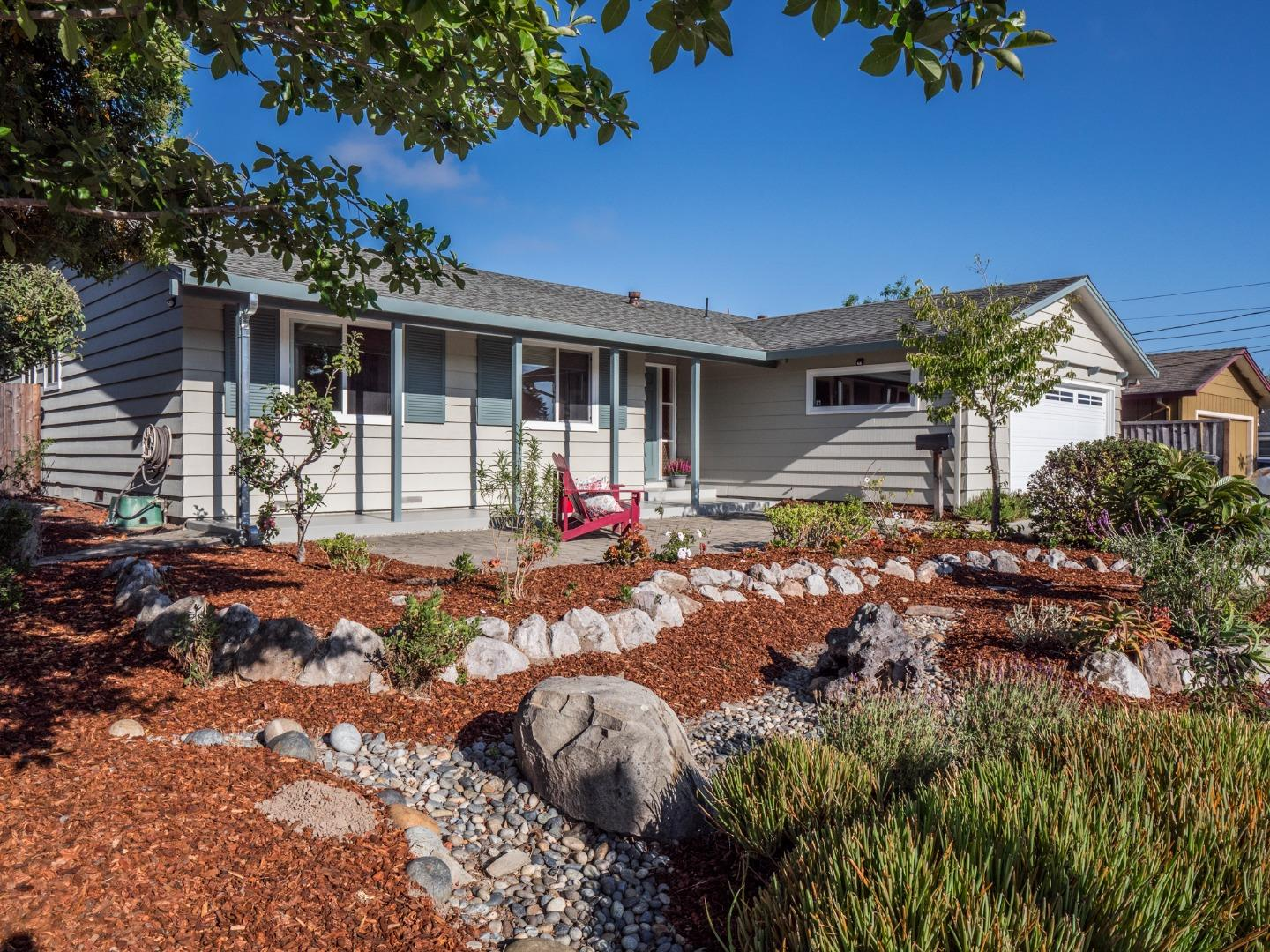 Just Listed in desirable Upper Santa Cruz Gardens Neighborhood!  Make this clean move in ready single level ranch style home your own.  Enjoy the light and bright open floorplan with updated kitchen and bathrooms.  Features include engineered maple wood floors, newer kitchen with quartz counter tops and island with built in gas range and oven, tons of natural light and a wood burning living room fireplace.  The living room sliding glass doors lead out to the generously sized back yard which is fully fenced with lots of room for outside activities and raised planter boxes perfect for vegetable gardening.  There is a two car attached garage with new concrete driveway.  All appliances are included.  Super convenient mid town location close to shopping and amenities and a short walk to Santa Cruz Gardens Elementary School, Santa Cruz Gardens County Park, neighborhood community pool and miles of hiking trails in the nearby greenbelt.