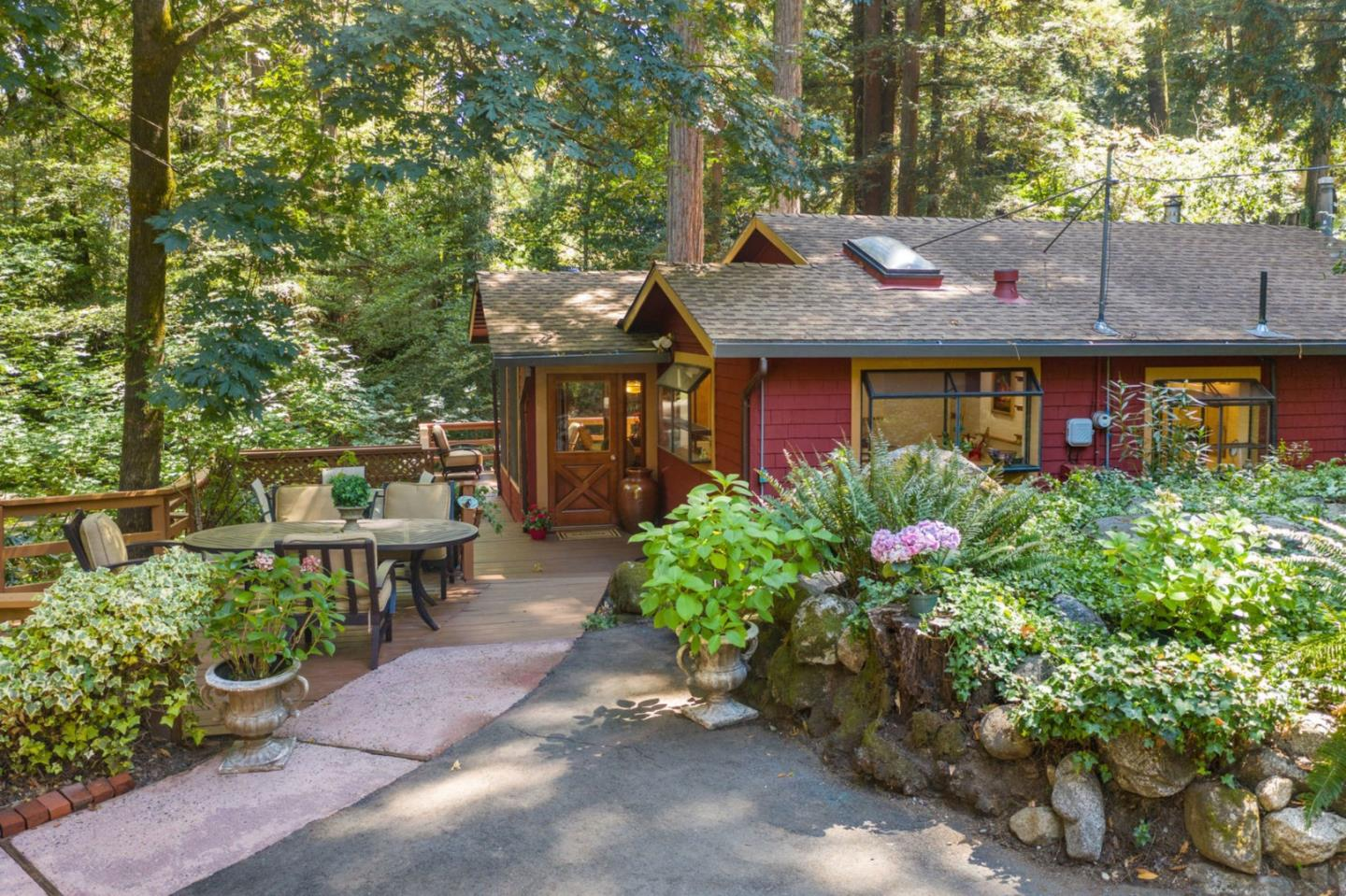 Welcome to your peaceful creekside home in our gorgeous Santa Cruz mountains! This 4 bed, 2.5 bath home is in a quiet neighborhood set nicely back from the street providing much privacy adding to the zenlike character this property undoubtedly portrays. Living room has old growth redwood paneling, and a fireplace giving the home an even cozier feel. Imagine yourself on a rainy night enjoying the sounds of the rainfall onto your skylights. Large dual pane windows in the kitchen and dining room offer lovely views so you can enjoy the beauty of the outside right in to your home as you prepare dinner or entertain guests. Kitchen provides plenty of counter space for cooking and great storage in order to keep your spaces tidy! The gazebo and private deck are both wonderful places to enjoy a cup of tea with a book as you listen to the calm sounds of the creek all right in your own backyard. Make this property your forever home or a dreamy weekend getaway retreat! Come see for yourself!