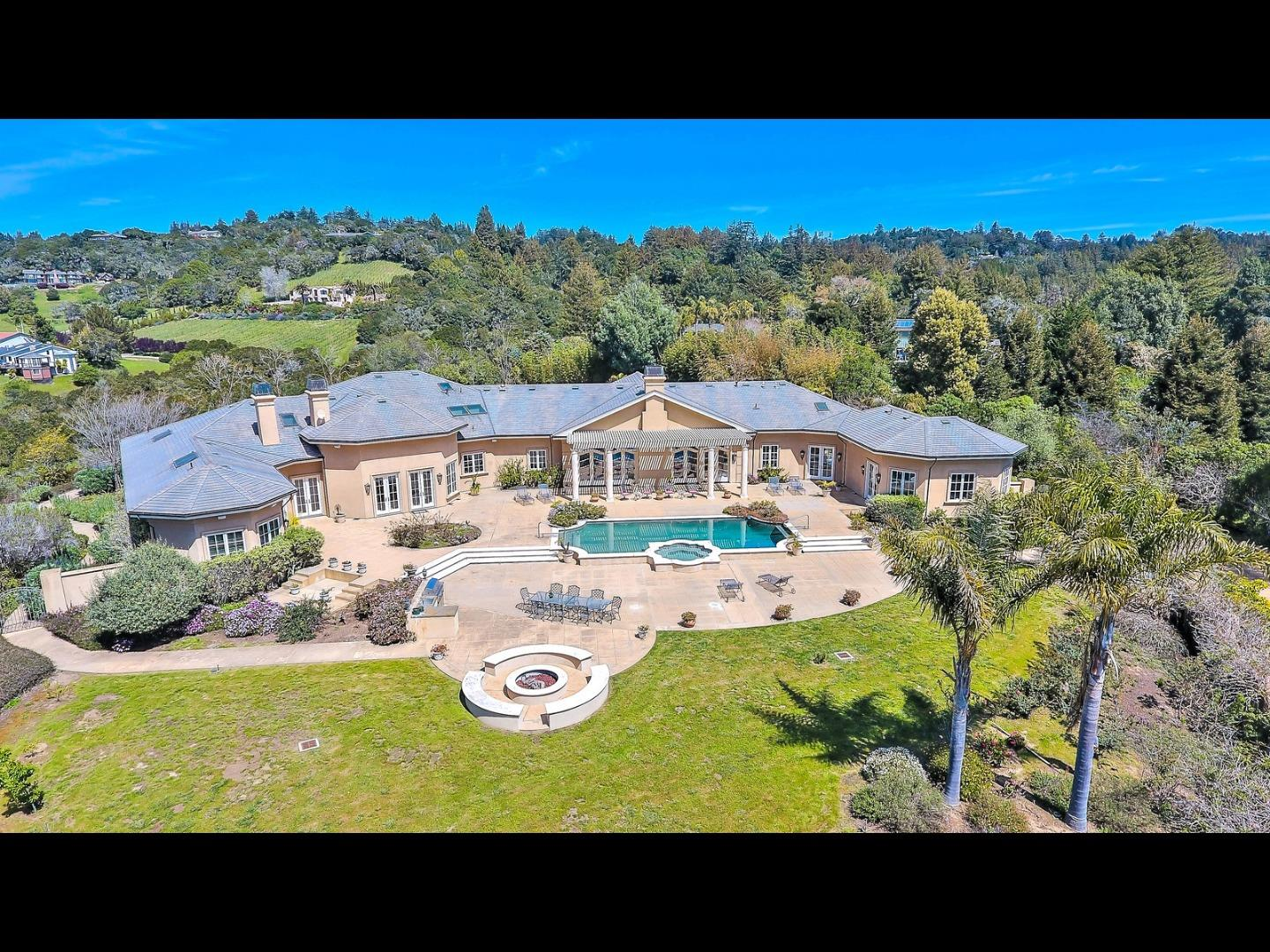 LUXURIOUS GATED ESTATE nestled in the prestigious hills of Aptos. Approximately 7,260 sf, almost 2.5 acres of elegant grounds, breathtaking views and privacy is ideally situated between Carmel and Silicon Valley. *3 master bedroom suites + separate office* All suites w/ their own private setting* Inside the architectural details prevail: Imported marble* silk wall coverings* vaulted, coffered & arched ceilings* Wainscoting *ornate moldings* majestic pillars* gleaming skylights* Gourmet kitchen: custom cabinetry, Wolf cooktop, Sub Zero refrigerator, and so much more* Butlers pantry w/ 300+ bottle temp controlled wine cellar* Grand master bedroom suite features 2 marble bathrooms* Vantage lighting & sound system* Pebble Tec pool & spa, expansive terrace, outdoor kitchen & more views* Long private drive w/ 6 car garage* Minutes to restaurants, shopping and beaches.  SELLER MAY CONSIDER RESIDENTIAL/COMMERCIAL TRADES