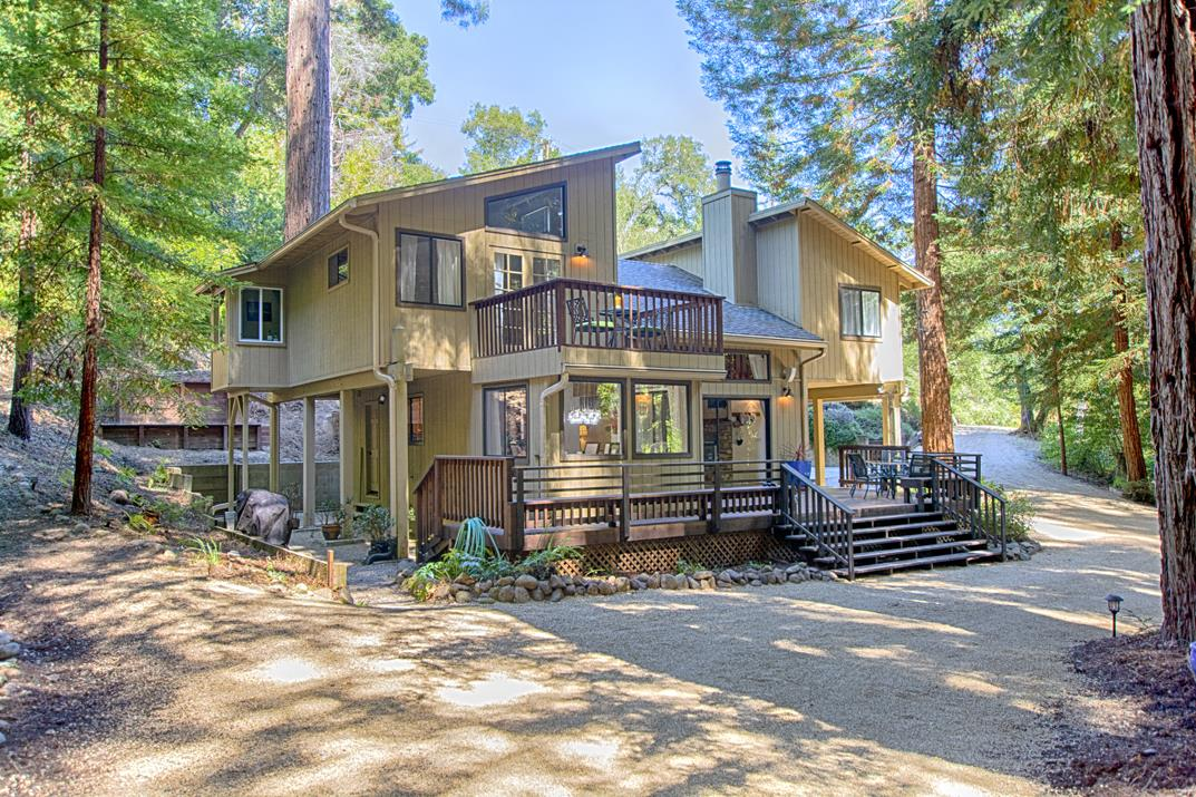 From the moment you turn onto the graceful gravel driveway, you know you are somewhere special. On 1.34 acres of groomed redwood forest, this well-maintained modern home provides complete privacy. The focal point of the living room is a European-styled RIKA Austroflamm pellet stove, and upstairs are 3 bedrooms and 2 remodeled baths with Carrara marble. Downstairs is another half bath and laundry. With storage galore, this gorgeous property is set up for self-sufficiency, with city water, a well + storage tank. Only 5 min to Boulder Creek and 25 min to downtown Los Gatos, truly exceptional.