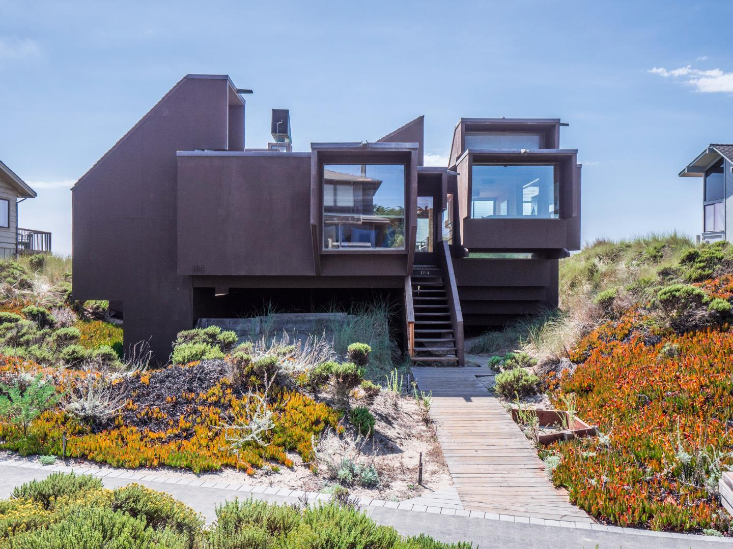 Beloved and unique beach house located on coveted front row of  beautiful and peaceful Pajaro Dunes. This  2049 square foot 3/3 home is perched on the dunes,  with an ideal ocean front location. The house is filled with lovely ocean sounds as well as warm, natural sunlight.  The open floor plan allows you to experience the daily views of the ocean and the evening sunsets , a truly treasured experience which has been enjoyed by the same family for over 30 years. The house has a mid century style with wonderful outside/inside California living flair. Excellent separation of space and several special nooks to explore make this home ideal for multi-generational families. There is plenty of room for everyone - wonderful family home to share with all your friends. This house lives like an every day home or a perfect vacation spot. Not to be missed!