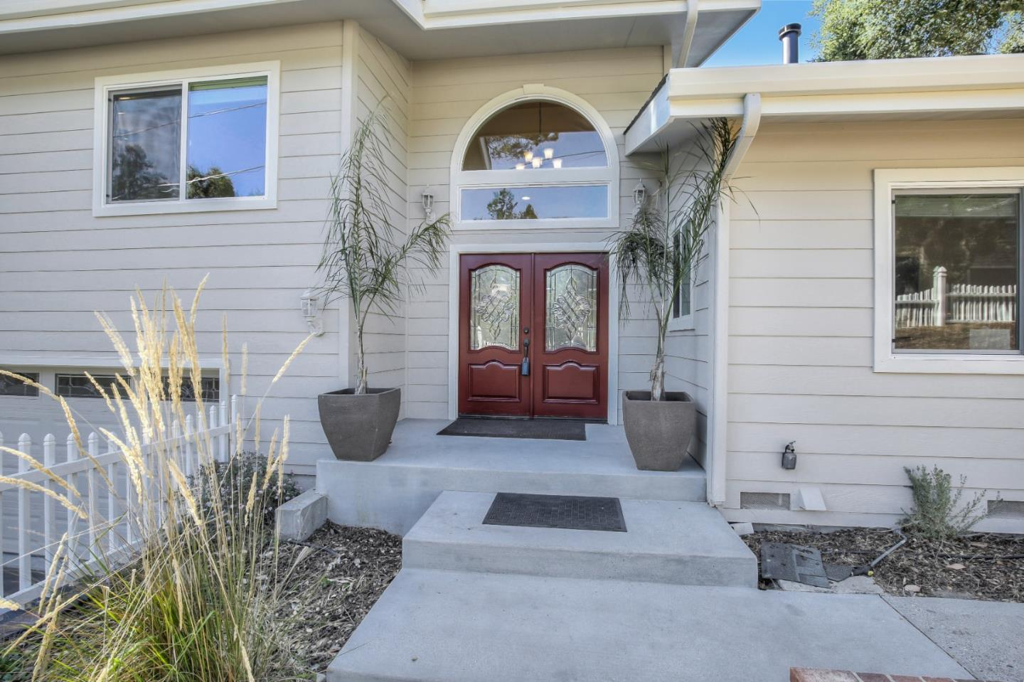 This Spectacular Ben Lomond property is boasting approximately 2,679 square feet and a huge 20,349 square foot lot in a fabulous neighborhood. The home was rebuilt in 2011 with the finest of materials and finishes. The large windows, sky lights and tall ceilings fill this home with natural sunlight. The kitchen is a chef's dream featuring high end cabinetry and Viking appliances. Youll always enjoy dining in the eat-in kitchen or dining room. The open floorplan is ideal for entertaining. Both the family room and living rooms have stunning wood floors, a fireplace and high ceilings. Relax in the master bedroom suite featuring large closets, soaking tub, oversized stall shower and a private deck. A separate entrance leads to a professionally soundproofed guest unit with one bedroom, one bathroom, laundry and a large private backyard. The properties oversized lot offers so much potential with possible ADU opportunity.