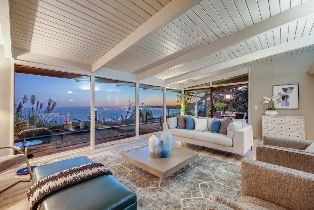 OCEANFRONT mid-century modern classic home nestled on a private 3.42 acre estate.Living,dining,kitchen & master all have breathtaking ocean views!Enjoy the magical sunrise&sunset.Large living room floor to ceiling windows showcase panoramic ocean views of the Monterey Bay.3 bed/2 bath,2118 sq ft, sounds of the sea, natural lighting & fresh ocean air epitomizes this single-story beach home.Master bath w/custom designed Italian tile,dual vanities &steam shower,private outdoor shower facing the ocean,gourmet kitchen w/Wolf cooktop & hood,SS appliances,quartz counters,bfast bar,open bright liv room w/fireplc+756 sq ft updated studio pool house w/kitchenette,full bath,PATH on PROPERTY leads through the woods &Borregas Creek,HIKE TO THE BEACH on your own property!nearby are miles of sandy beaches,remodeled village of Aptos,Capitola,UCSC,Cabrillo College,&minutes from fine dining,shopping,award-winning schools & Nisene Marks State Park.RARE opportunity to own private ocean front property.