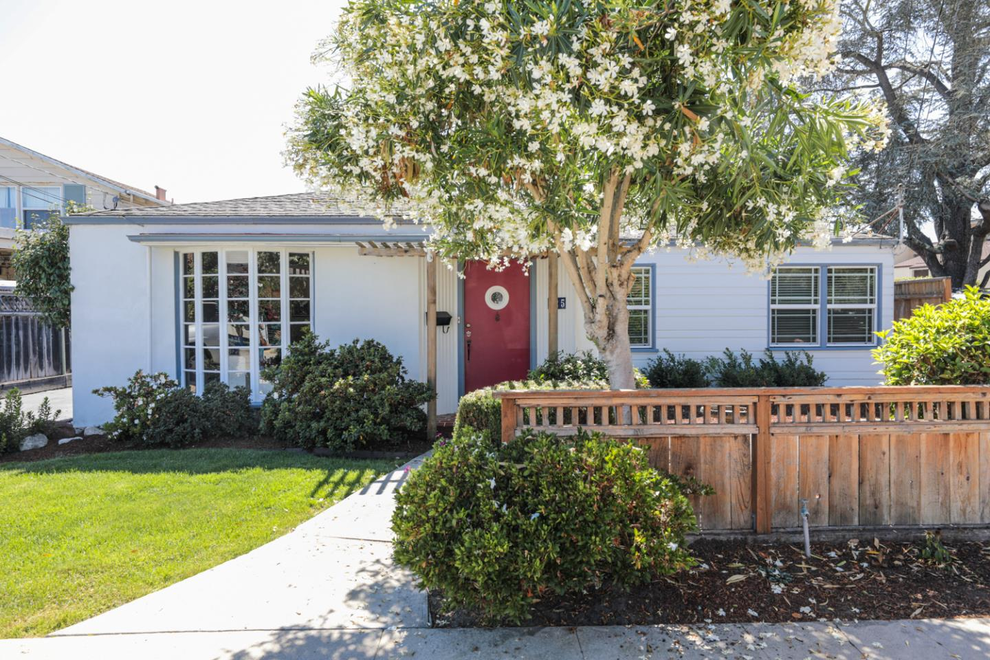 This charming home in sunny Eastside Santa Cruz is close to the beach but not the beach traffic! End of street privacy & quiet, excellent neighborhood, easy walk to restaurants, stores, the beach, The Buttery & quick access to Hwy 1 & 17. This well-maintained home has real oak hardwood & Italian tile floors, plenty of light throughout & is turnkey. The updated kitchen features beautiful cherry cabinets & granite counters that extend into the dining room creating an open floor plan. The kitchen has all stainless steel appliances. The master bedroom faces the beautifully landscaped backyard with a large patio & lighted pergola, perfect for entertaining or just relaxing in the shade. Gardeners will love the raised garden beds, mature grape vines & dwarf apple tree. The updated bathroom has a floating vanity, laundry room with service sink & a large 2 car detached garage with storage and ample parking. Easily add a 2nd bathroom too. So many great things about this home - see for yourself.
