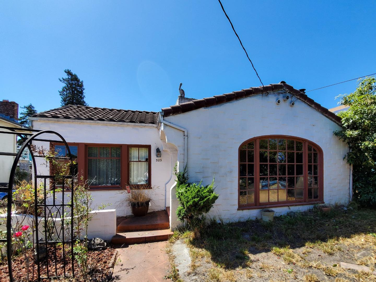 Opportunity knocks! A classic Westside Santa Cruz bungalow, centrally located near UCSC, this charming 2 bedroom, 1 bath home offers a great floor plan with spacious rooms. It includes a large living room with a big picture window and fireplace, a formal dining room with coved ceiling, a huge updated kitchen with breakfast nook, oak cabinets, granite counters, tile floors and gas stove. There are 2 big bedrooms and a generously sized bathroom with tub and dual vanities. There is also an inside laundry/utility room. There is an additional room in the back of the house that is partially constructed which would be a fabulous master suite when completed. There are hardwood floors, and some dual pane windows. Spacious backyard and detached garage. This home offers a wonderful opportunity for a contractor or someone willing to do some repair and renovation work. It has great investment/rental potential too because you have a premium location near UCSC and downtown Santa Cruz.