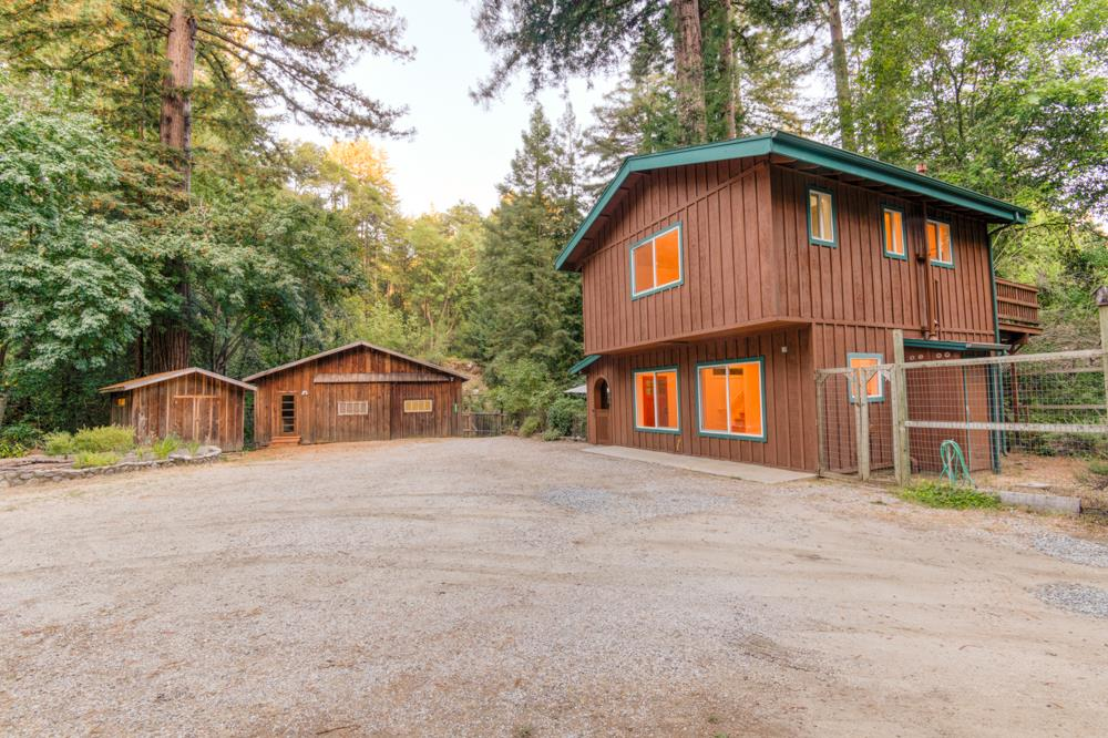 Magical setting along the San Lorenzo river on a level approx 1/2 acre lot .  Huge 1,000 sq ft barn offers many possibilities,  The current configuration is an oversized 2 car garage, and two large bedrooms with view of the river. Storage area under barn. Enjoy your very own private sandy beach on the river.  A shed adjacent to the barn which can be used as an artist studio. And a magnificent two story 2 bedroom 1 1/2 bathroom house built in 2000.  The towering redwood trees add awe to this fairy tale setting.  Next to the house is another permanent shed which houses a generator. Ample onsite space to park your RV, boat, bikes etc. Property is bordered by the river and a seasonal creek.  Easy commute to Silicon Valley and only 30 minutes to the ocean.  Come see your new home. Buyer to investigate the possibility of converting barn to guest house or ADU.