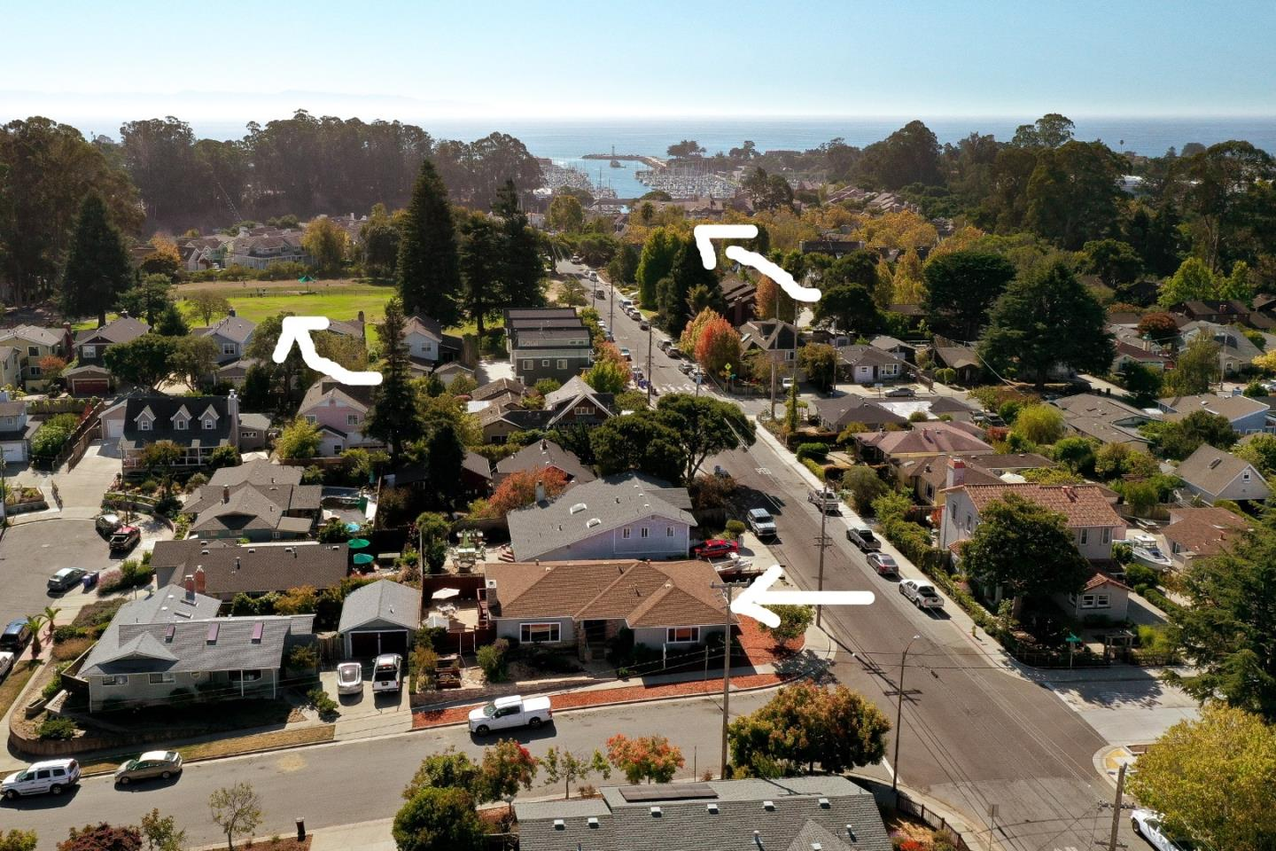 Enjoy a relaxed rhythm of life  in the heart of Eastside's most desirable neighborhoods! A short walk on close by trails or a quick bike ride to the yacht harbor, Arana Gulch greenbelt and to the cool midtown restaurants and shops-just a quick stroll to Frederick St. Park and dog park.  Location is away from typical beach traffic but close to everything including freeway and shopping. This home has more of a mid- century flair and style. Spacious, single level boasts lots of natural light, bamboo floors and fresh paint with a welcoming and bright living room. Other features include dual pane windows , stainless steel appliances with a brand new dishwasher and a cozy fireplace, updated copper plumbing. Corner lot with low maintenance yard, lovely calming ponds greet you at the door, backyard flagstone patio with pretty views from the back deck. Easy beach living in this Eastside, Seabright and Harbor location! It's all about location!