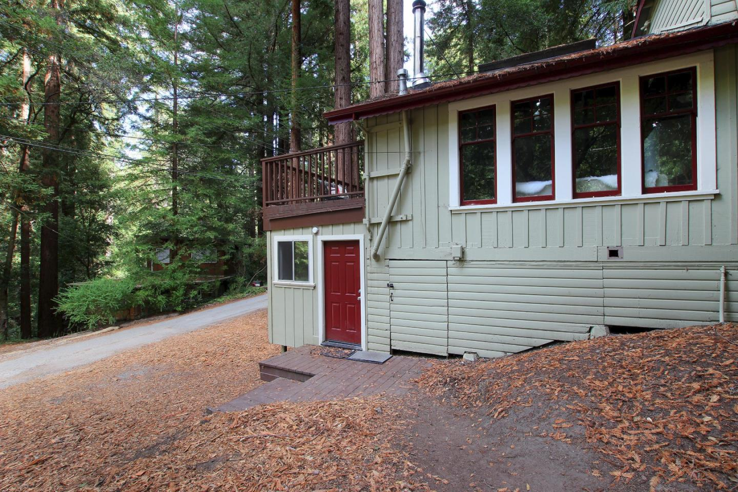 This home captures the wonders of living in the redwoods. The living room with Beautiful wood floors an open beam ceiling, wood burning stove and wood sash windows make this a room to settle into. Kitchen opens up to a great dining or family room with French doors out to the back and side yard. This is a 2+ bedroom, 2 full bath, with a great cloak closet. The decks wrap around the house for great entertaining and outdoor lounging. Inside laundry and extra storage. Located in Forest Lakes Community and minutes from Henry Cowell Park and downtown Felton.