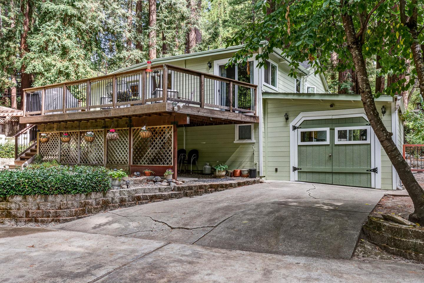 Open House Sunday Nov 10 1-4 pm. Mystical & Magical setting among the tall redwoods!  This home is located in a very desirable neighborhood of Boulder Creek.  The home is ready to move in with new high end bamboo flooring and updated kitchen and bath.  Great open concept floor plan make the home feel much bigger than it is.  The master suite has a newly designed walk in closet.  Guest room next to master opens onto the large back deck and a 3rd guest room/office which is small but functional.  Stone fireplace, recessed lighting, dual pane windows and updated plumbing leaves little to do for a new owner.  Private entrance to the laundry and an additional space located off of garage could be perfect for hobby or guest room.  The yard is perfect for entertaining with outdoor kitchen, spa, fire pits and lawn area.  With 10,240 sf of usable property its ideal for nature lovers.  Plenty of off street parking for up to 6 cars and RV.