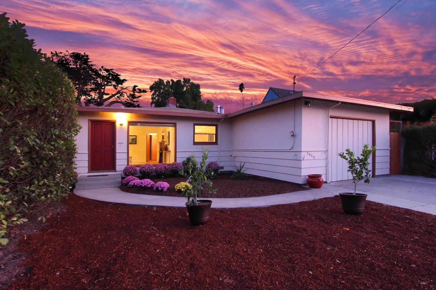 Over 5% price reduction. Seller will credit $5000 toward repairs/upgrades. This home's prime location is just blocks from the West Cliff Promenade and doors away from the Bethany Curve trail to the ocean cliffs. The house has been completely painted in and out, and features hardwood floors, a fully remodeled bathroom, and original retro tile in the other bathroom and in the kitchen. The over-sized picture window in front awaits your decorative coverings and brings light in a from a the front yard. The back yard runs deep. Zoned R2 this is an exceptional opportunity for an investment rental, a primary residence, or as a coastal retreat with half the home rented. Pears and a prominent Magnolia grace the backyard, and a private wrap-around deck gives peaceful access to the yard. The master suite has both a slider to the outside and a separate door to a private entrance, and a door to the rest of the home. The property was used as a second residence and as a rental for the past 20 years