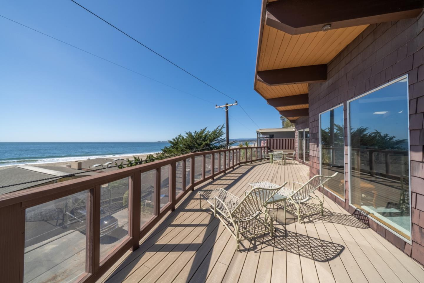 Mid century style with white water views, imagine the possibilities! Located behind the gates on Rio del Mar's Beach Drive, where the sand and surf are steps from your front door. Designed to maximize the sights and sounds of the seashore, featuring two oversized living spaces, both with ocean blue views as far as the eye can see. Reverse floor plan features four bedrooms, separate family room, exposed beam ceilings, abundant natural light and open concept great room with kitchen, living and dining rooms all perfectly intertwined to create an entertainers delight.Enjoy viewing spectacular sunsets, migrating whales and soaring pelicans from both inside and out on the two large decks off the great room and family room. 3 car garage provides a place for all the beach toys and more. It's a lifestyle you have been dreaming of, a home away from home, with that one incredible piece that is at the top of your wish list... the VIEW.Relax and SEA what time on the coast can do for you!