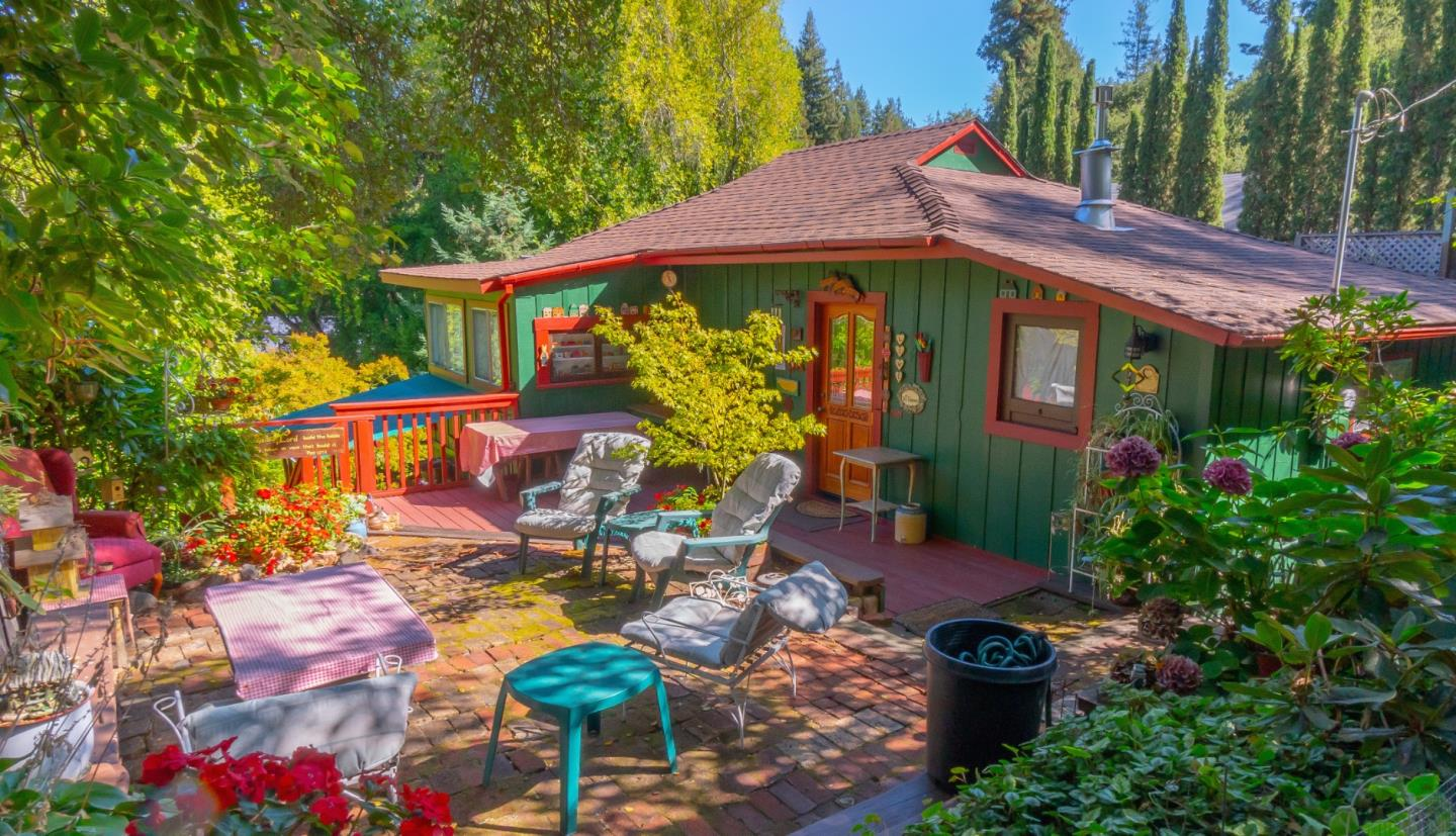 This quaint and whimsical Mt Hermon cabin is overflowing with old world charm and has recently been functioning as a popular Airbnb. Records show 2br, but lives like a 3br + office! Entering main floor from large upper patio area, you will find a spacious family room surrounded by bedrooms, office, bathroom, and covered deck. Downstairs is kitchen, separate dining room, and laundry room, which opens up to lower patio and garden. Lots of sun and greenery make this peaceful home feel very private, yet it is in a fantastic family neighborhood. Expansive mature gardens with lots of room to play or possibly expand? Memberships to Mount Hermon Conference Center available for small fee, includes use of pool, zipline, boats, trails, and more! No HOA but there is a road maintenance fee of $440/year. Property may be accessed from Lakeside Ave or Mound Ave and sale includes 2 adjacent (mostly flat) parcels. Prime commute location, only 5 mins to Felton and 10 mins to downtown Santa Cruz.