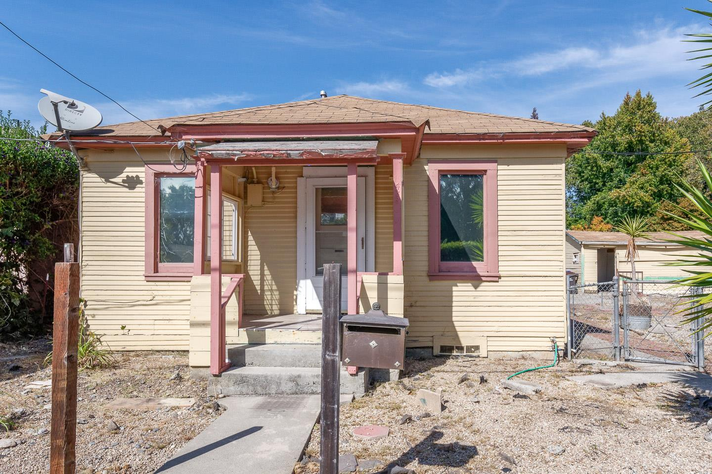 This property has deferred maintenance and will require significant renovation. Home is situated on a corner lot and has a detached single car garage. This is a Probate Sale subject to court confirmation and possible overbid.