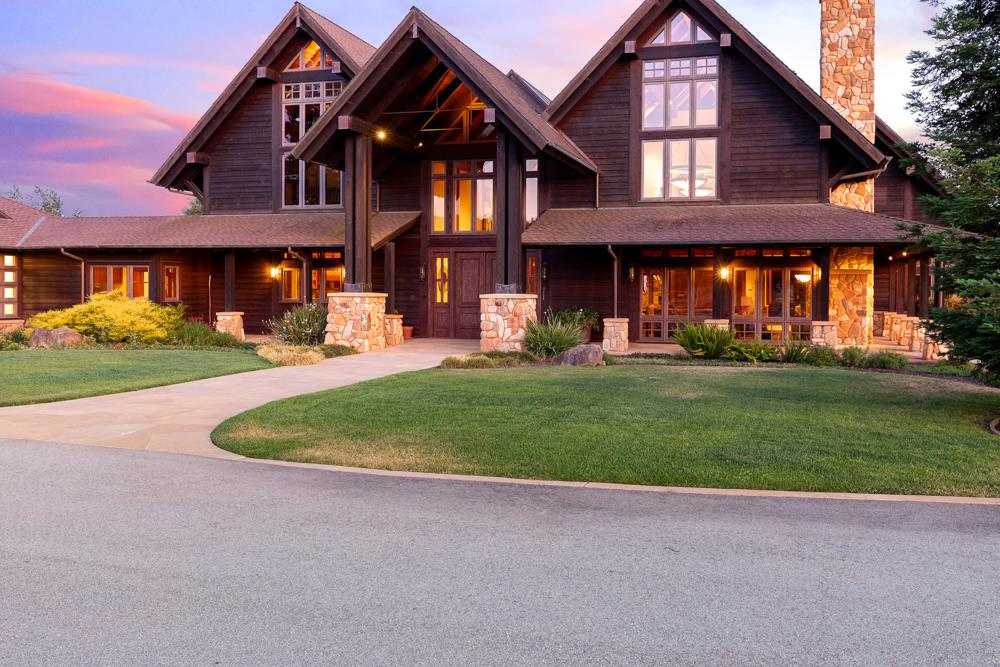 Destiny Coyote Ranch...Five years in the making, a spectacular design of nearly 7,000 square feet by renowned architect, John Blackburn, bestows the finest of materials, huge timbers exquisitely crafted, river rock meticulously fitted, a magnificent home on 80 acres in a hidden valley with panoramic views of the Aptos hills, and with it a world-class equestrian complex and stables.The living room and dining are grand; the chefs kitchen, an open design with a large center island, state of the art appliances and a large walk-in pantry. The master suite, on the first floor, offers a vaulted open beam ceiling, a stone-crafted fireplace, steam shower and copper soaking tub. There are three additional en-suite bedrooms upstairs. On four separate parcels, enjoy orchards, vineyard, 8-stall show barn, 3 arenas, cleared riding trails, farm to table garden, near the Corralitos Wine Trail, short drive to Silicon Valley, Monterey, Carmel & just down the hill to sugar-sand beaches of Santa Cruz.