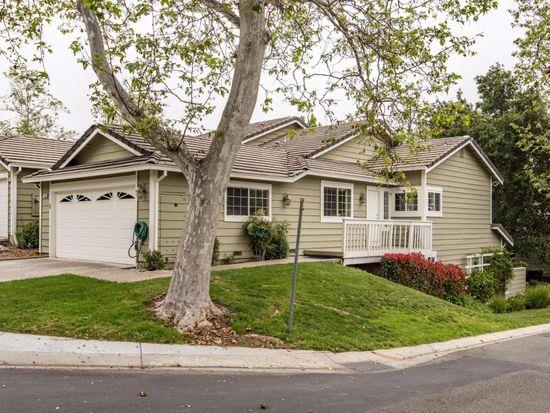 Exquisite townhome on a tranquil, tree lined street in the sought after California Ridge community with views of surrounding hills. This corner unit is across the street from a grass field perfect for relaxing or playing outdoors.  Tastefully updated corner unit with vaulted ceilings and lots of natural light. 3 spacious bedrooms and 3 full baths, with 1 BD /1 BA at the main level and 2 master suites downstairs. Kitchen was remodeled with new cabinets, granite counter tops, and all new appliances.  Living room features a  beautiful marble fire place and private deck. Dual pane windows, laundry inside, new central forced air (heat & A/C). Awards winning top Almaden Valley schools Williams Elementary, Bret Harte Middle and Leland High.  Don't miss your chance to come see this stunning unit in a great community