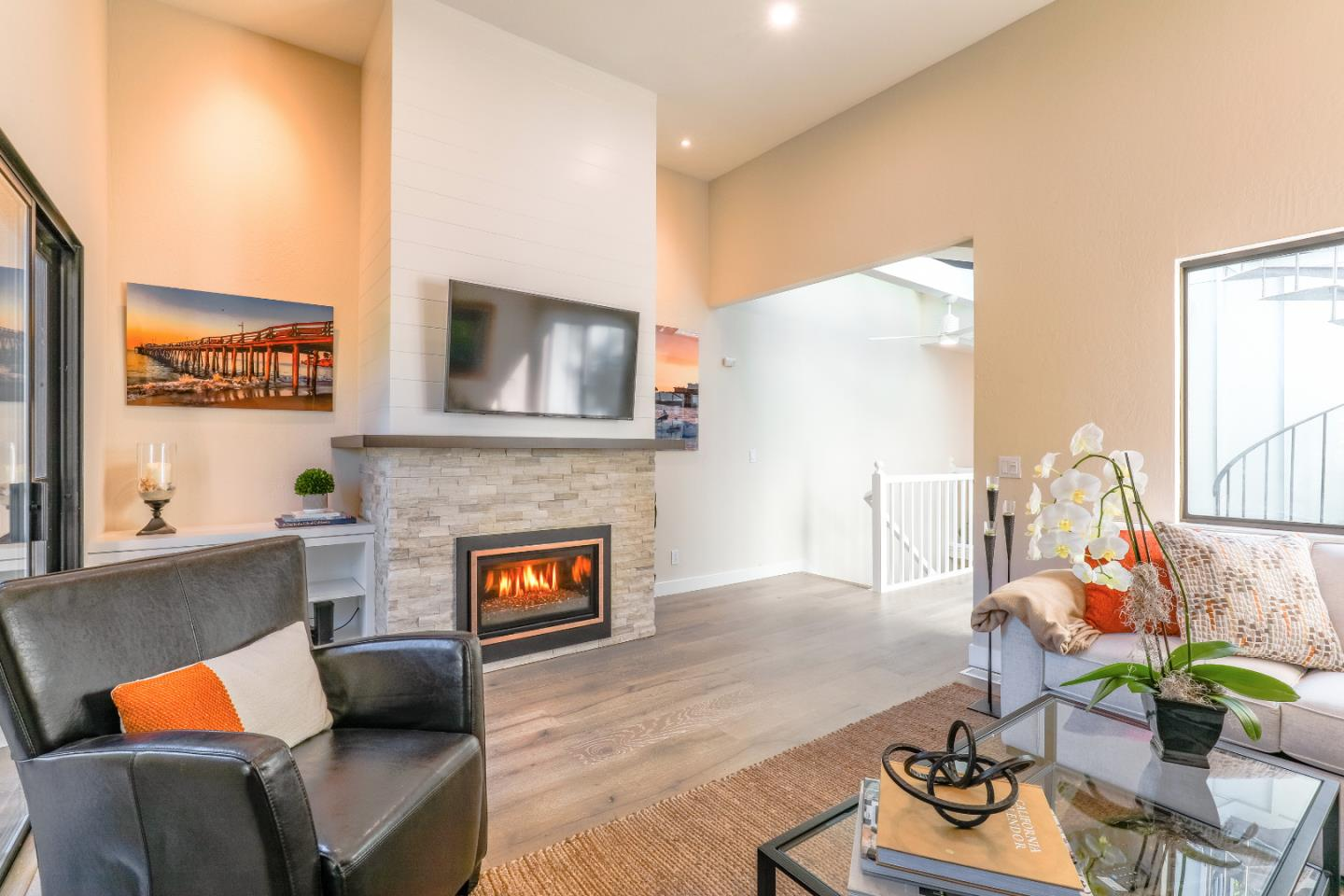 Enjoy the coastal lifestyle in this completely remodeled townhome just 1 mile to Capitola Beach & Soquel Village. Nestled in the trees above Soquel Creek, this gorgeous townhome was professionally designed with all of the latest luxurious amenities. From the wide plank hardwood floors throughout, gorgeous lighting fixtures & recessed lighting, walk-in shower in master, custom cabinetry, stainless steel appliances, Quartz countertops, fresh paint throughout, even gas replaced the electrical for the chefs out there. Oh, did I mention the stunning stackstone fireplace? Great entertaining home too with a reverse floorplan, private patio and multiple balconies and even rooftop deck! Pull into your large 2 car garage with abundant storage and you can walk minutes to Gayles, Shadowbrook, parks, beaches & of course Capitola & Soquel Villages! Really too much to mention,  head to toe finished for the year round resident or for your weekend retreat. Turn key and ready to go! Video coming too!