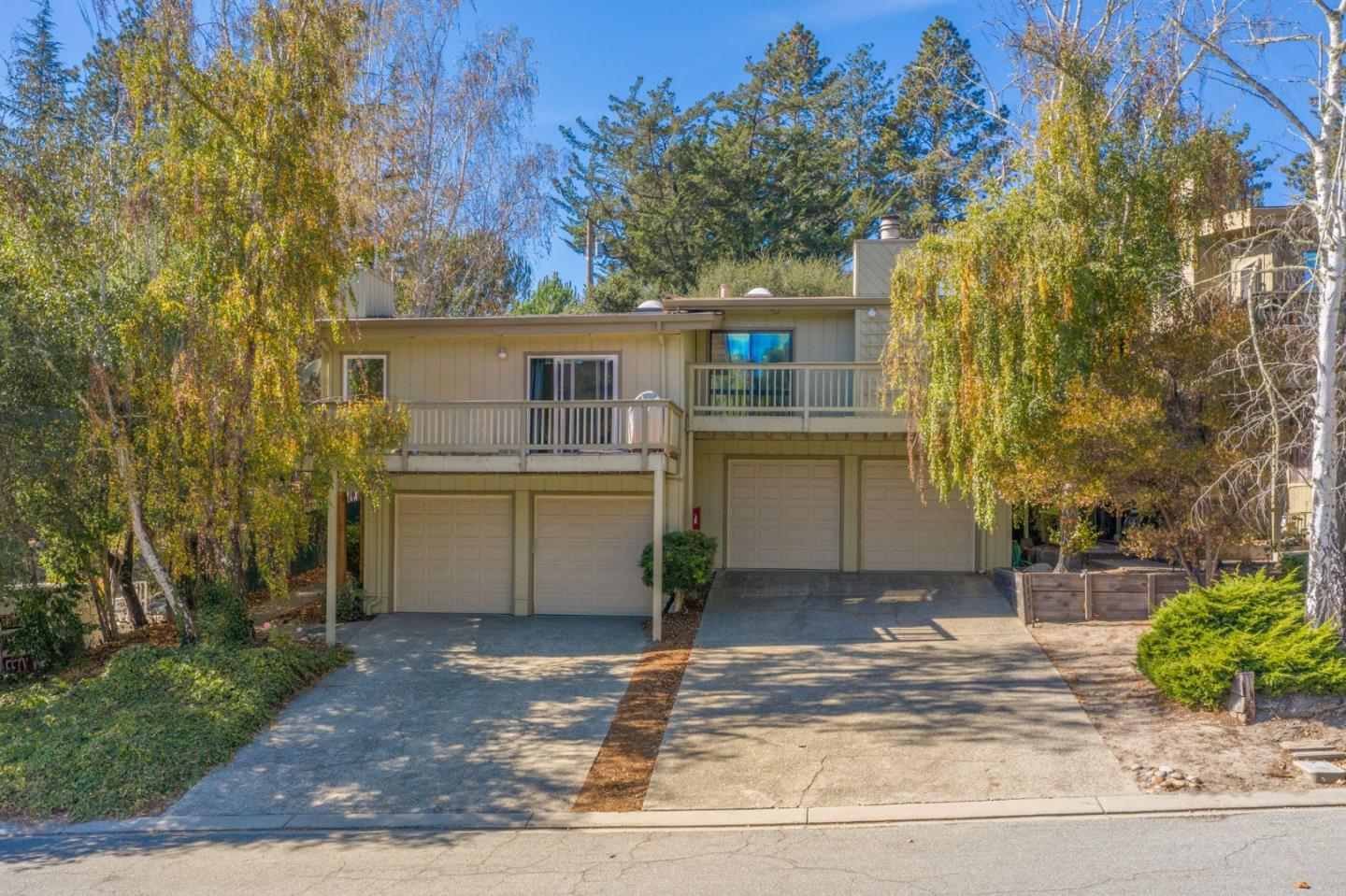 Contemporary 2BR/2BA townhouse located on a highly desired, tree-lined cul-de-sac in Scotts Valley. This lofty two-story home elegantly displays vaulted ceilings, skylights, and a wood burning fireplace. The open concept kitchen is designed for convenience with lots of counter space, dishwasher, and oven/range combo. There are 2 good sized bedrooms and 2 beautifully updated bathrooms. The master suite features sliding doors out to the backyard. The attached garage has space for two large vehicles as well as two parking spaces in the driveway. Whether you want to enjoy the sun set behind the mountains on your deck, BBQ in the private backyard, or walk over to the neighborhood park, this home gives the owners a variety of outdoor entertainment options. Close to Kings Village shopping center with restaurants, movie theaters, grocery store, plus great schools nearby. Short drive to beach, hiking, and quick & easy freeway access.