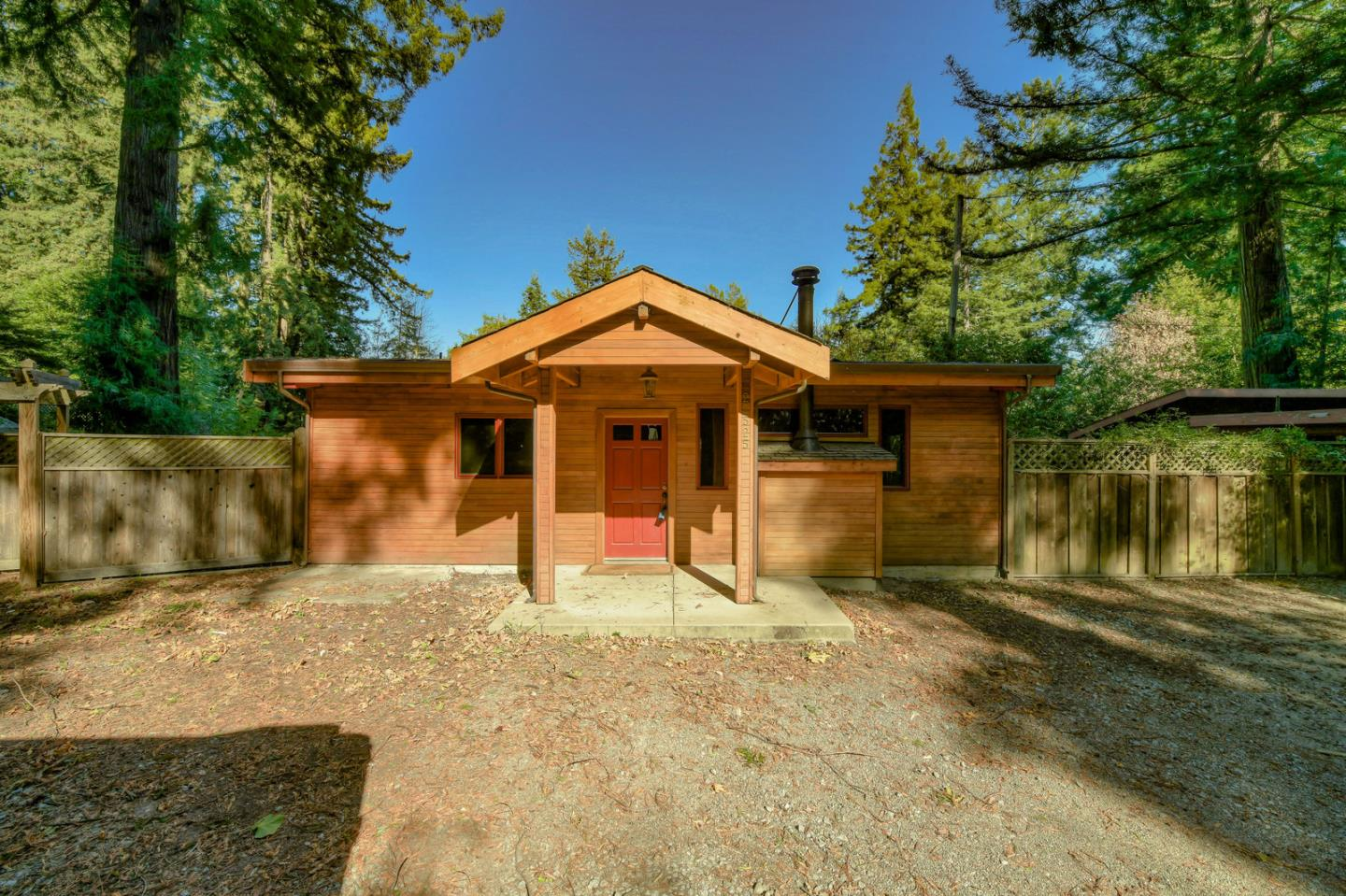 Conveniently located on nearly half an acre only 1/2 a mile from Hwy 17, set back from Summit Rd. Set on a flat lot with lots of sun exposure with room to expand. This charming single story home boasts an open floor plan with vaulted ceilings, exposed beams, hardwood floors throughout & Sierra Pacific dual pane windows. Gourmet kitchen with large island and granite counter tops. Spacious private back yard with mountain views. Detached office/art studio. 2 car detached garage. Excellent schools - Loma Prieta Elementary, CT English Middle, Los Gatos High.