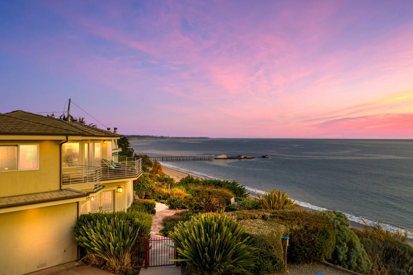 "Oceanfront garden paradise located behind a private gate set above the Seacliff Beach bluffs moments to beach access. Inside & out the home boasts BIG ocean & Monterey Bay views including views of the iconic Seacliff ""Cement Ship"" at the forefront. Multiple living areas open & adjoin to the gourmet kitchen with granite counters & cherry cabinets looking out big-picture windows to take in the incredible scenery. Upstairs bedrooms connect to a large wrap-around balcony offering panoramic coastal & ocean views. The master suite has a cozy sitting area with a fireplace, huge walk-in closet, & luxurious bath. A downstairs bonus room attaches to a full bath, a great place for guests, an office or hobby room. The grounds offer lush gardens & multiple areas including a deck for dining, fire pit with sitting area, custom stone walkways & a lower patio at the point of the bluff. One car garage with ample parking. Unwind & entertain, take in the evening sunsets & hear the crashing of the waves."