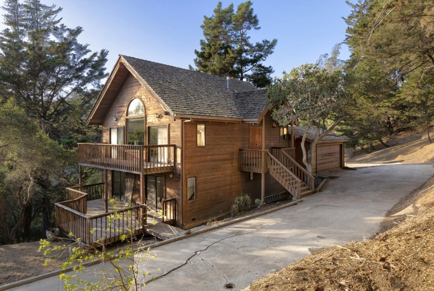 Tucked in the hills of Aptos Hills-Larkin Valley is a unique three story home waiting for a little bit of TLC. The foundation and framework are in good condition; a wonderful opportunity for someone to implement their design esthetic to truly make it their own.   Built in 1987, this single-owner home sits on a 6 acre lot and has 3 bedrooms and 3 bathrooms. Constructed in a reverse floor plan, the top entry level gives you the essence of a Lake Tahoe property with vaulted wood exposed ceilings, a loft area with a small bonus room attached, and large windows to view the beautiful surrounding trees. As you head down to the second floor, you will find all of the bedrooms with a master bedroom that includes an ensuite and reasonably sized closet. The third floor has a huge bonus room that could be the perfect playroom, game room, or whatever type of room you desire.  Other features include accent fireplaces, private driveway, and enclosed garage. A lot of land and house for a fair price!